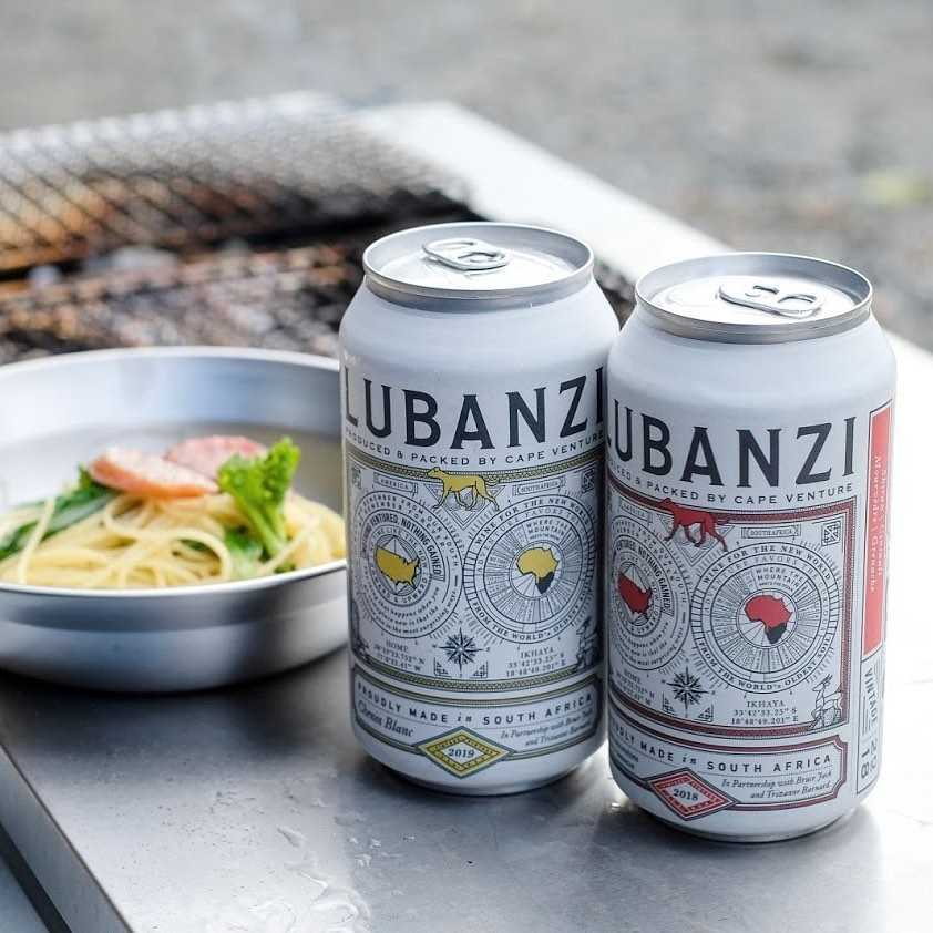 canned wine on outdoor counter beside food