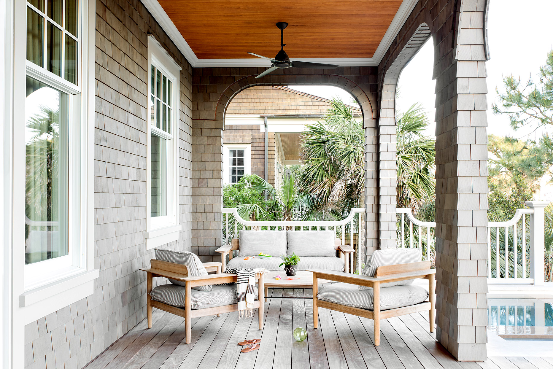 Wooden porch with seating and table