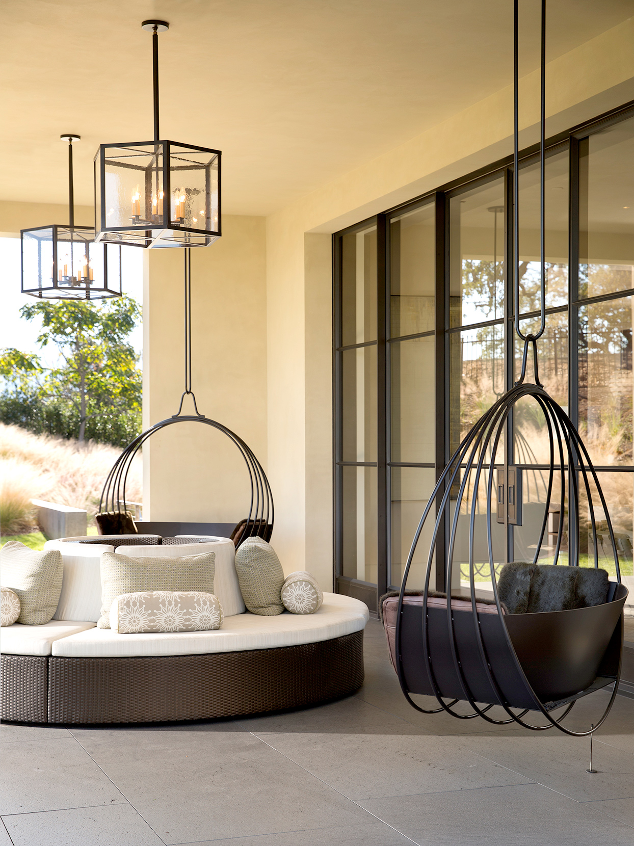 Outdoor seating with round couch and hanging chair