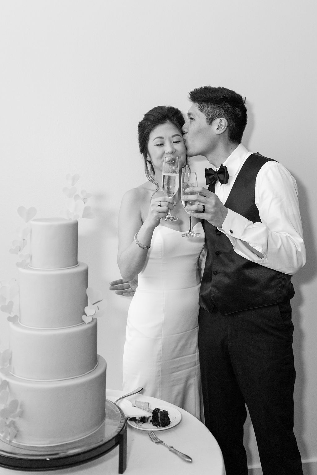 bride and groom toasting champagne after cake cutting