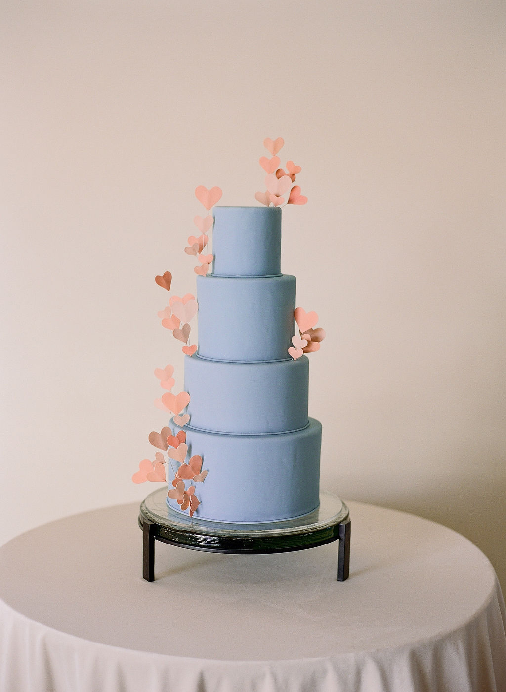 blue fondant wedding cake with pink flowers