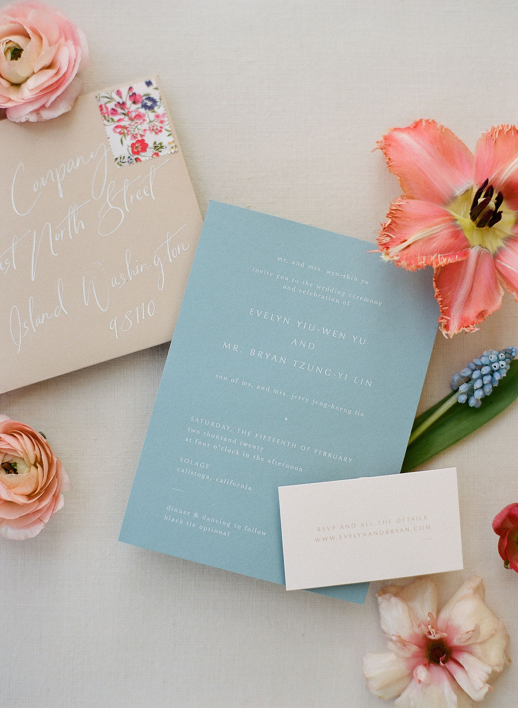 blue, tan and pink wedding invitation suite with flowers
