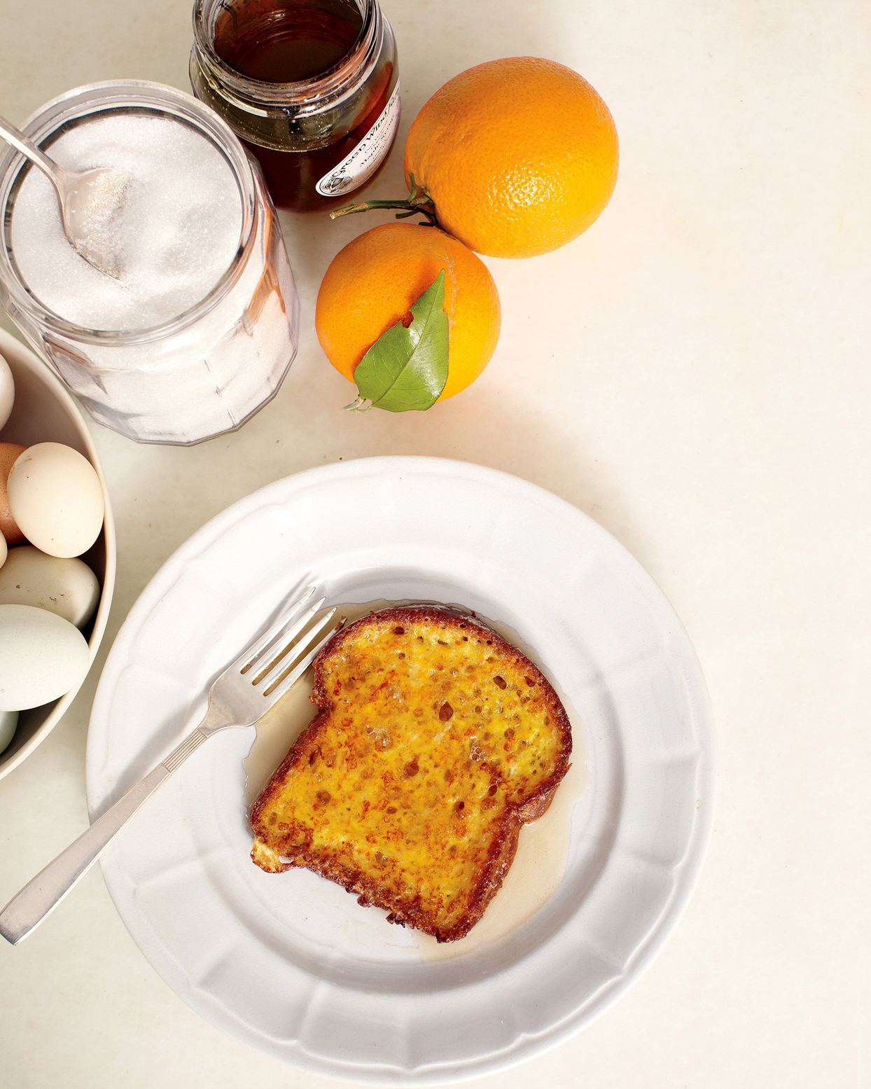 plated french toast and oranges