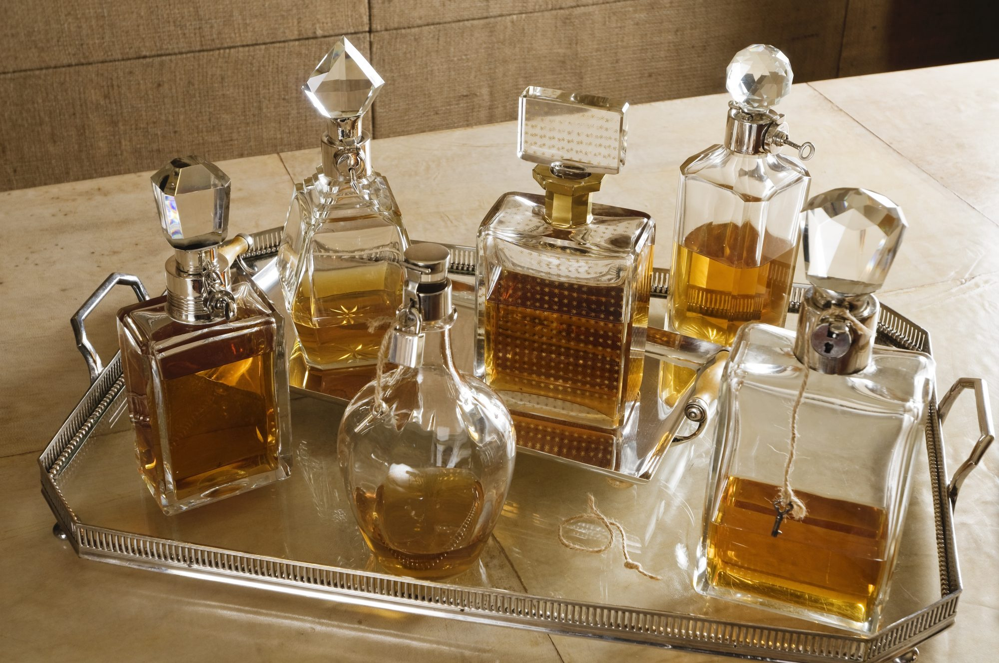 silver tray of decanters