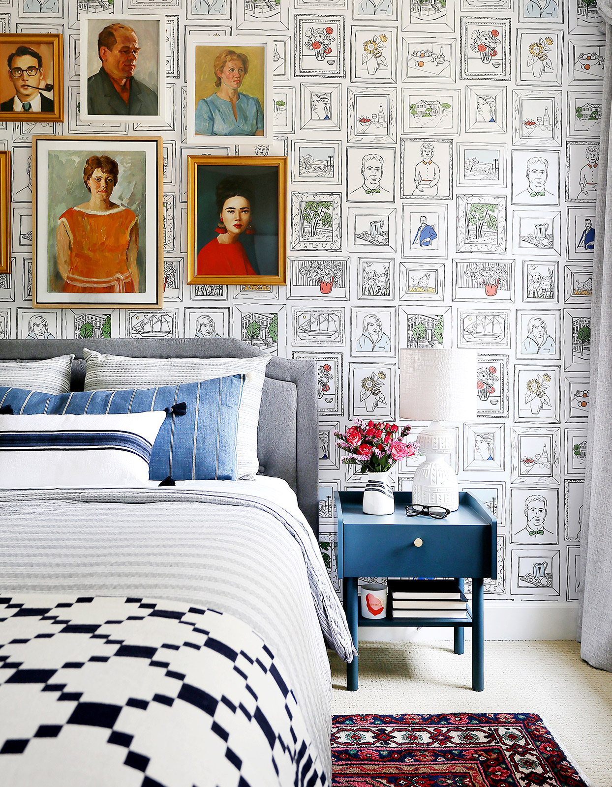 Bedroom with illustrated wallpaper