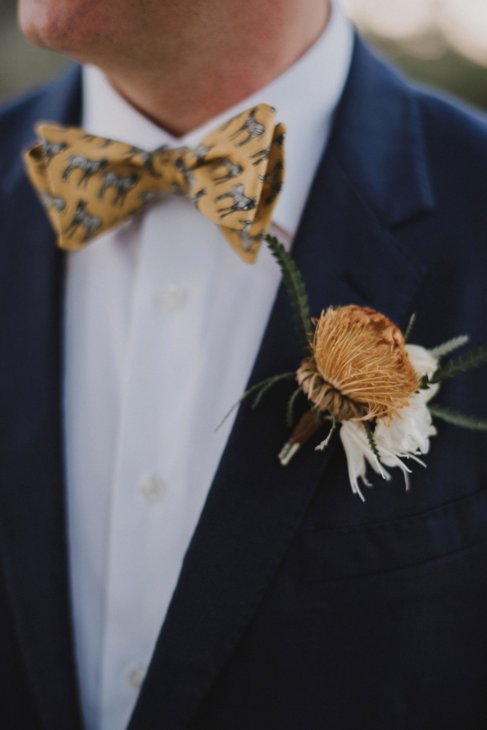 grooms zebra bow tie and boutonniere