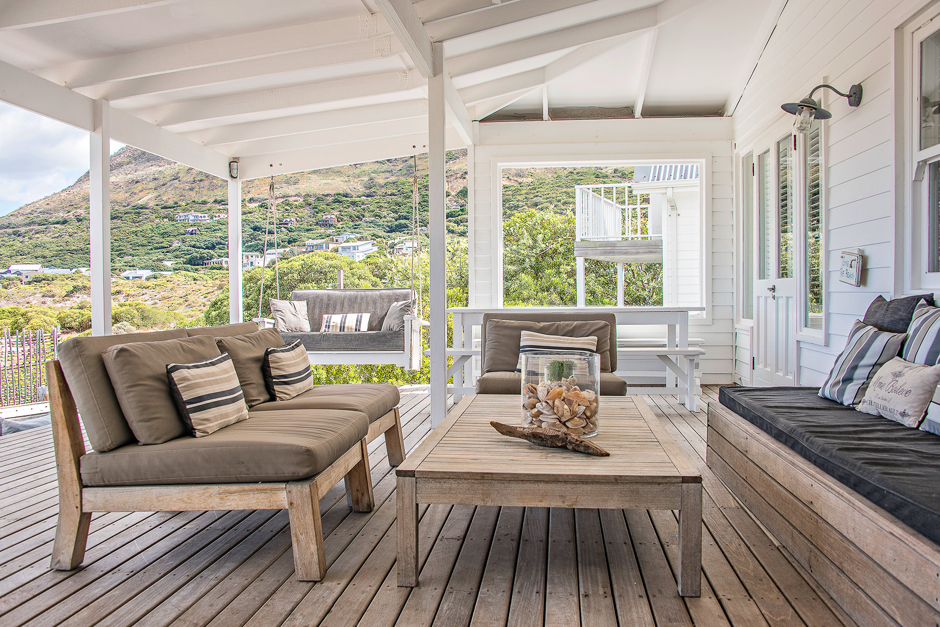 outdoor patio with roof and wooden furniture
