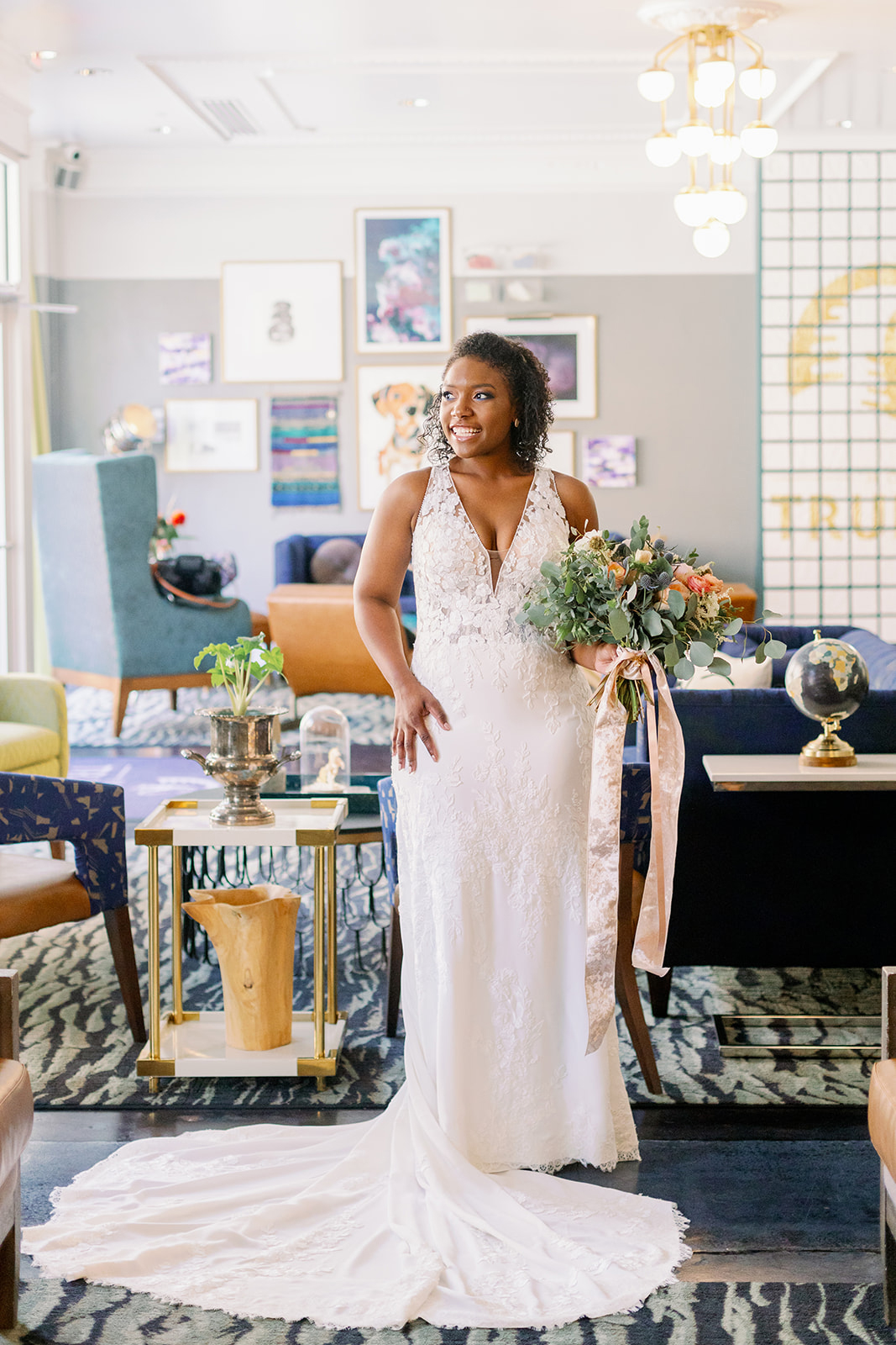 bride in white lace wedding dress in colorful room