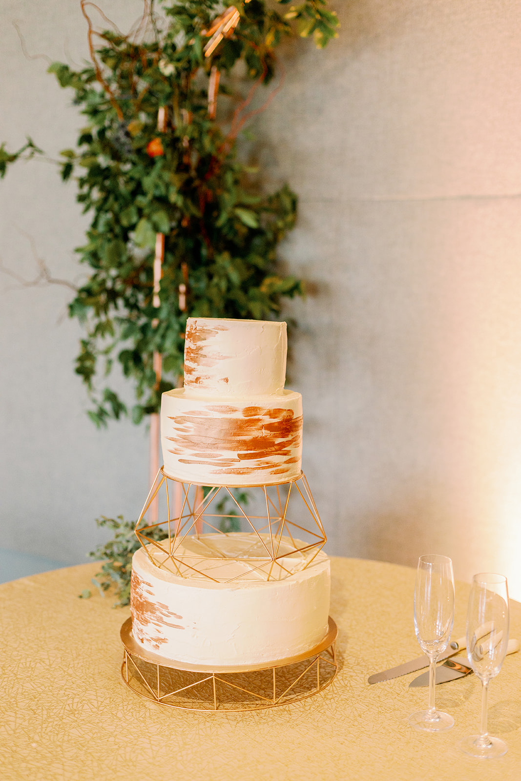 white and gold wedding cake with geometric risers