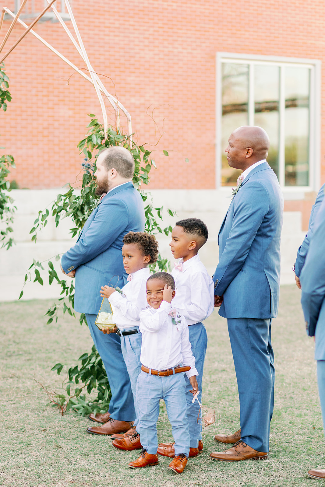 groomsmen and ring bearers in blue at wedding ceremony