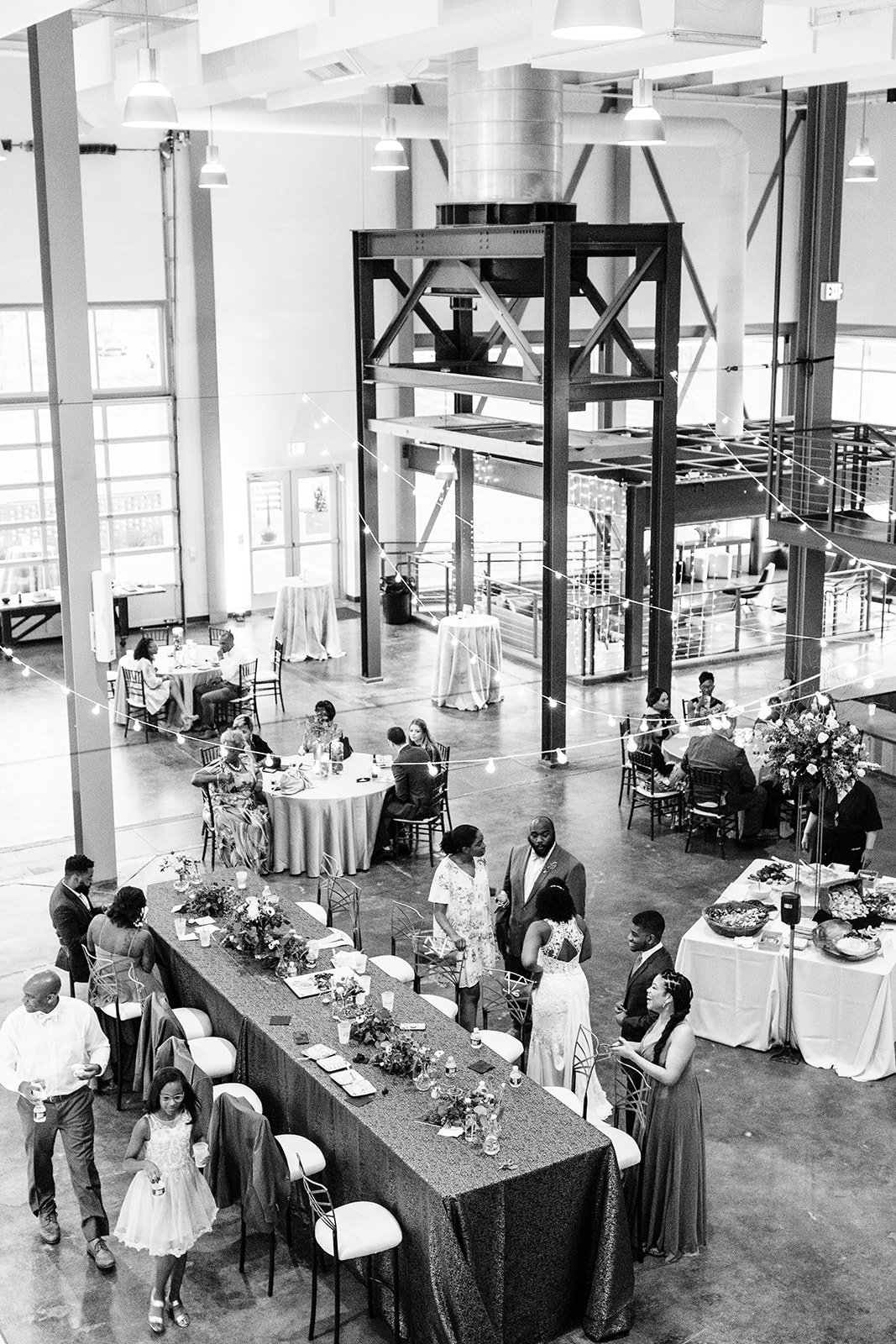 guests mingling at wedding reception in industrial space