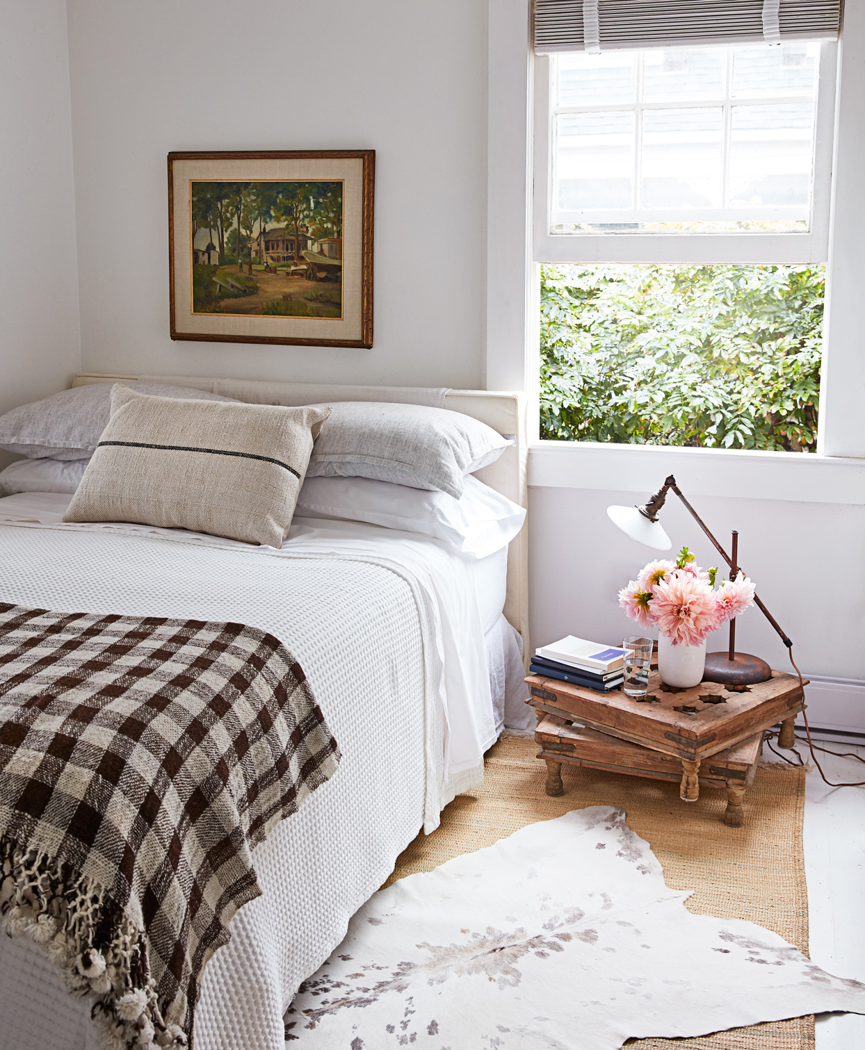master bedroom with stacked tables as nightstand