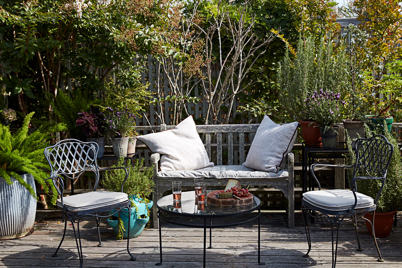 seating atop wooden deck surrounded by garden