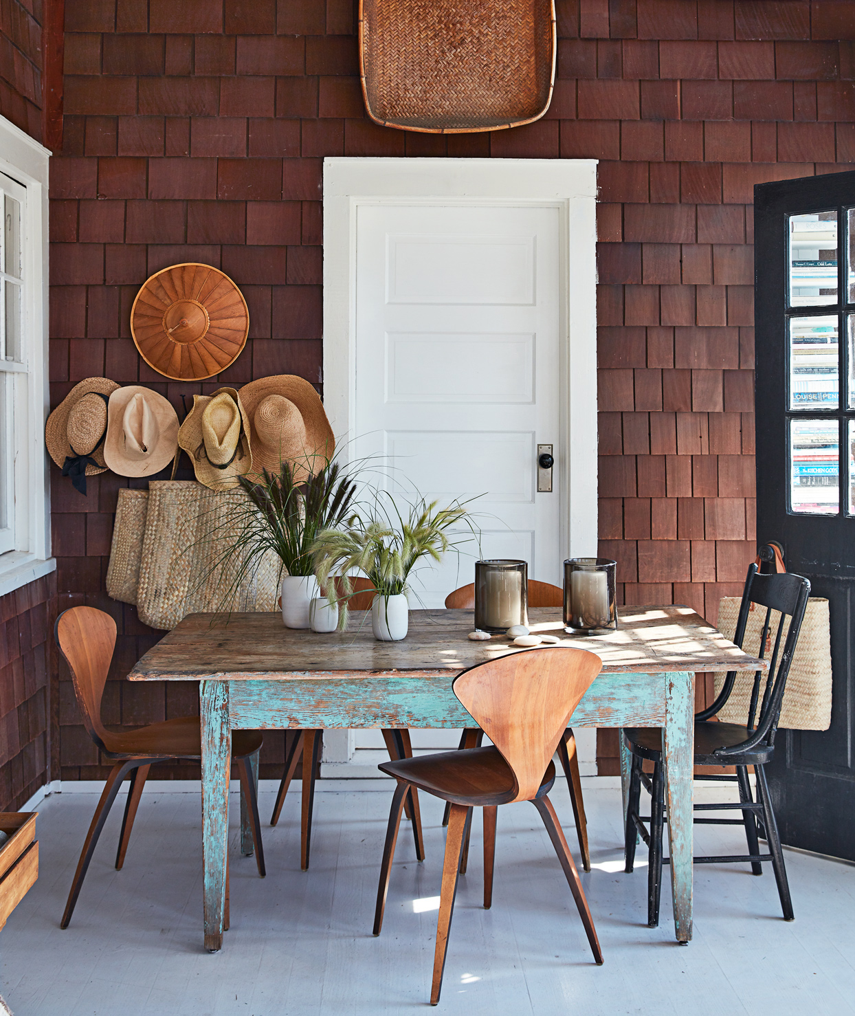 front porch with rustic outdoor dining room