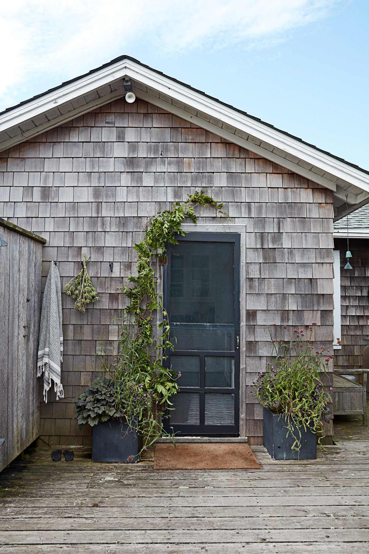 cottage backdoor and outdoor shower