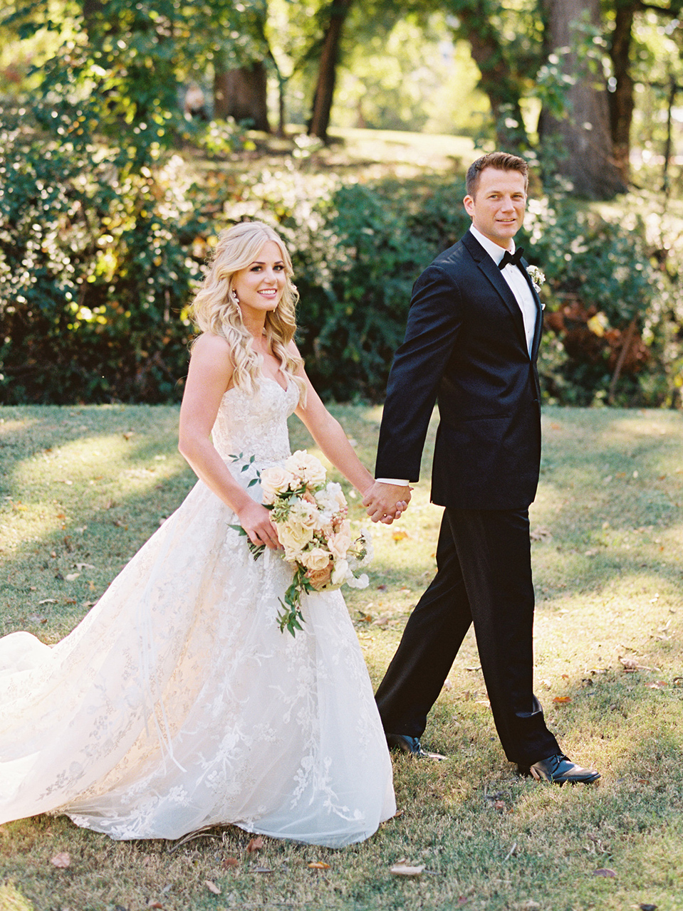 bride groom holding hands outdoor walk