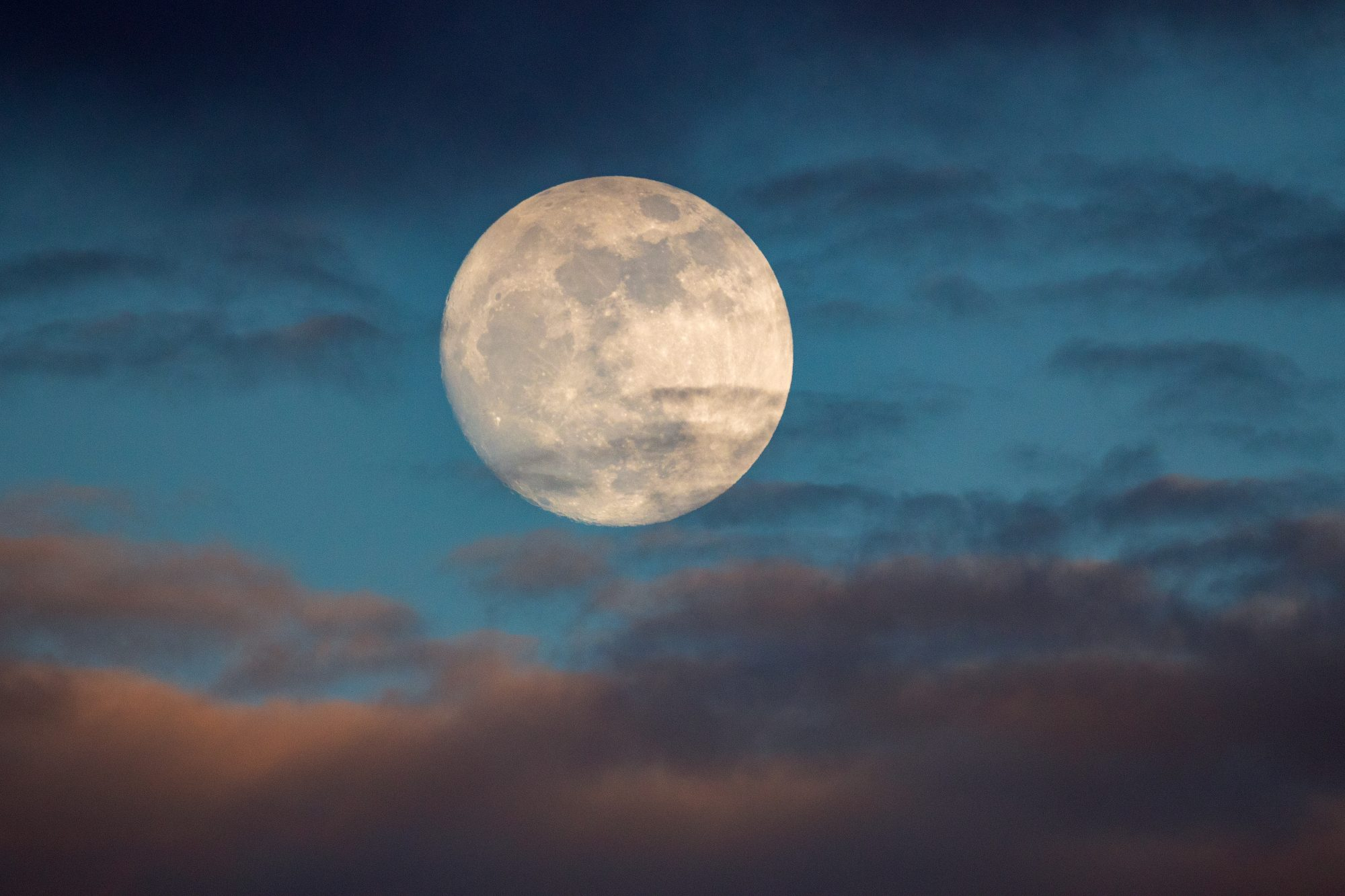 supermoon surrounded by clouds