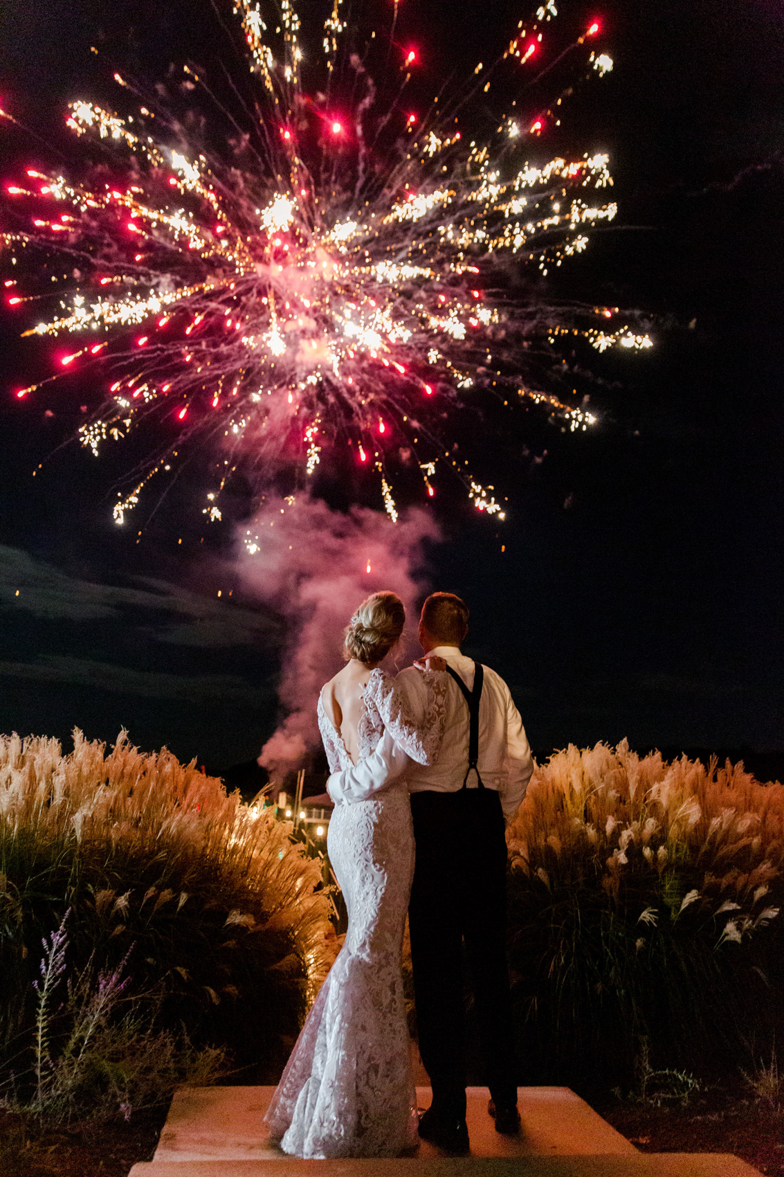 couple embracing watching fireworks