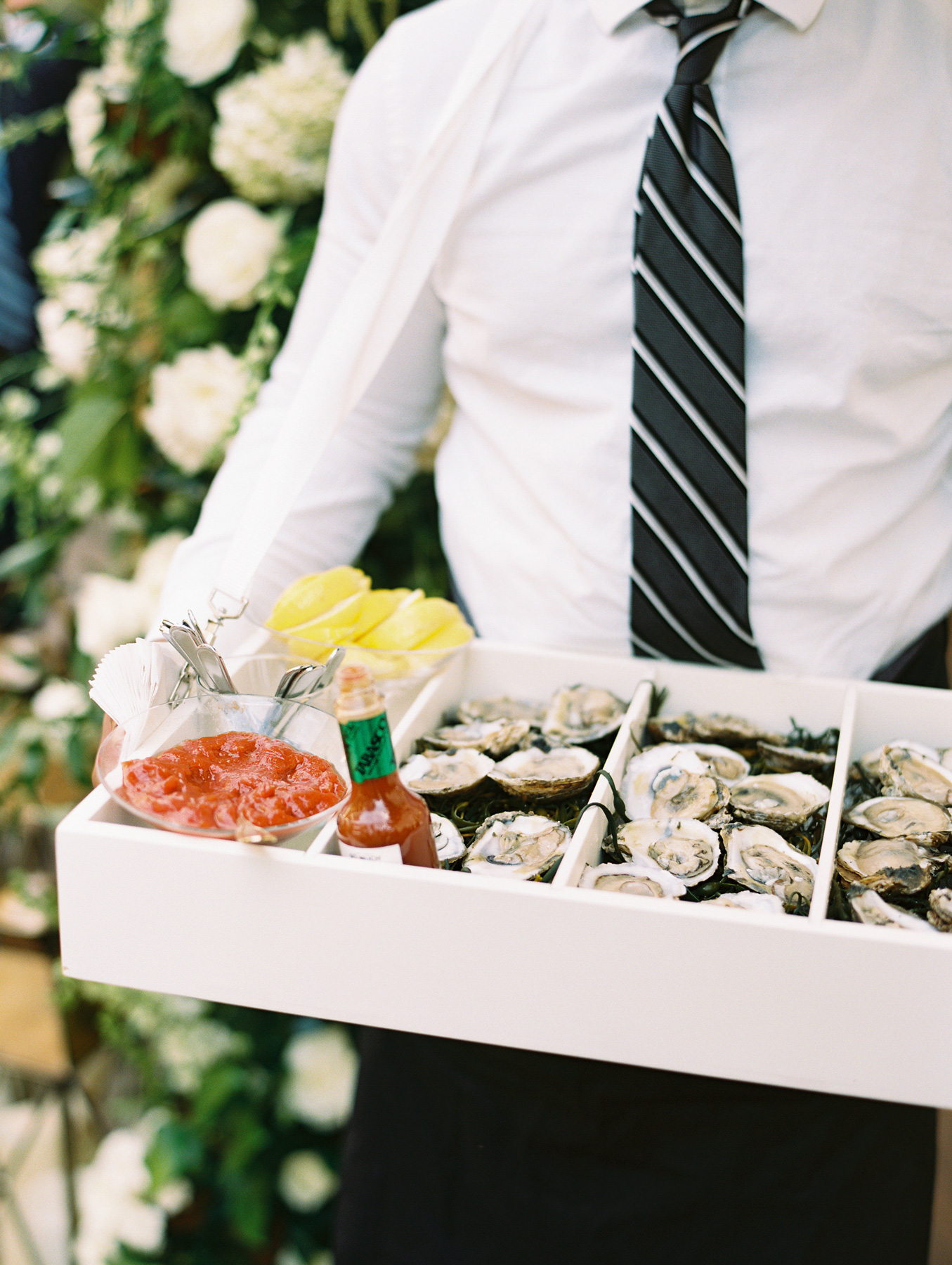 close-up of oysters and sauce in serving box