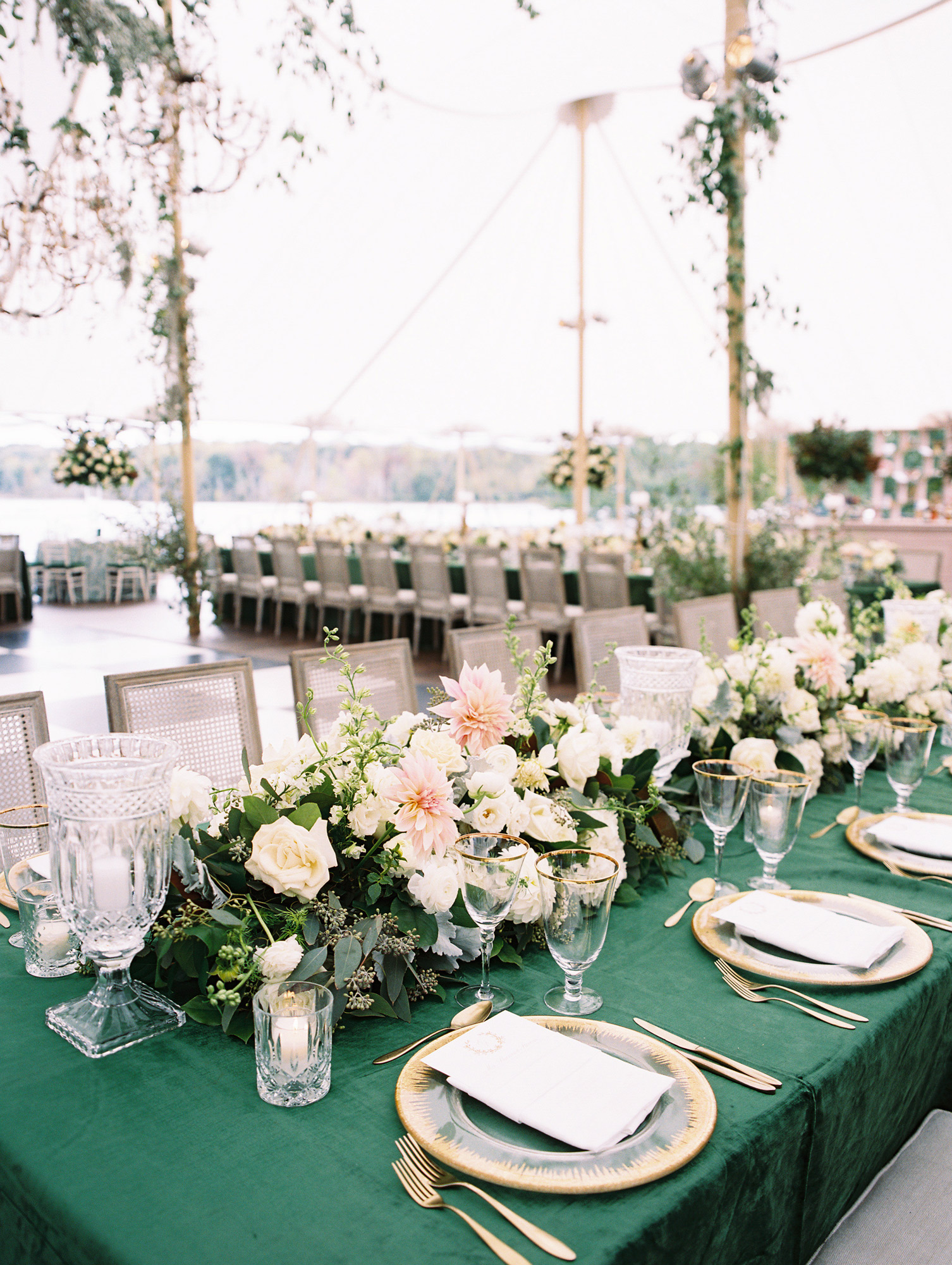 reception tables with green tablecloths floral centerpieces