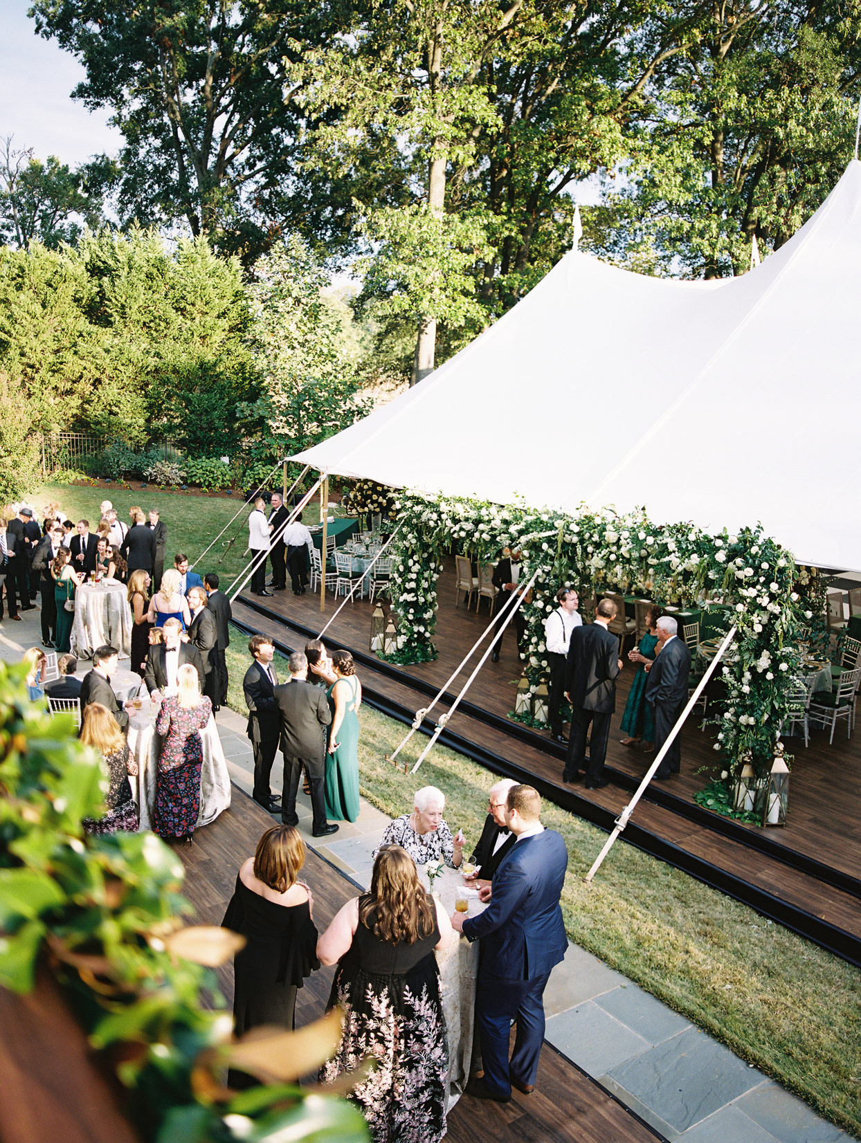 guests and outdoor wedding tent
