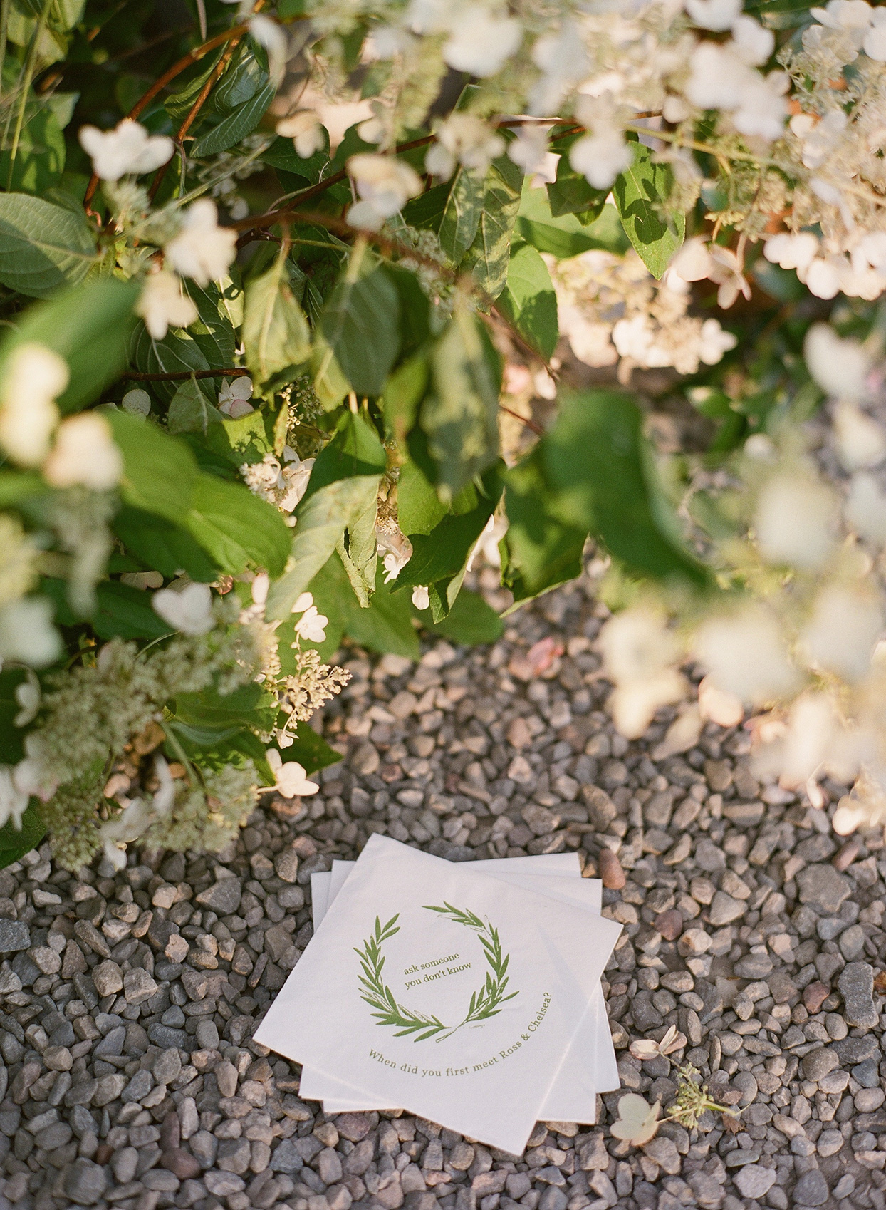 customized rehearsal dinner napkins and greenery