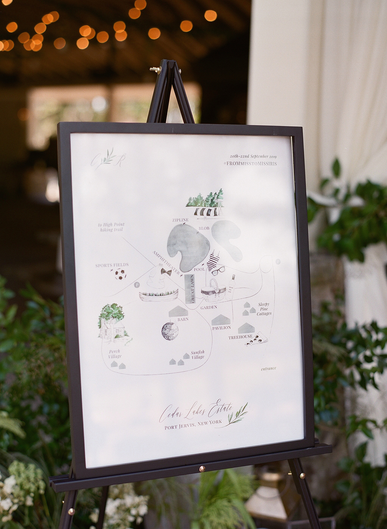 map of rehearsal dinner locations on easel