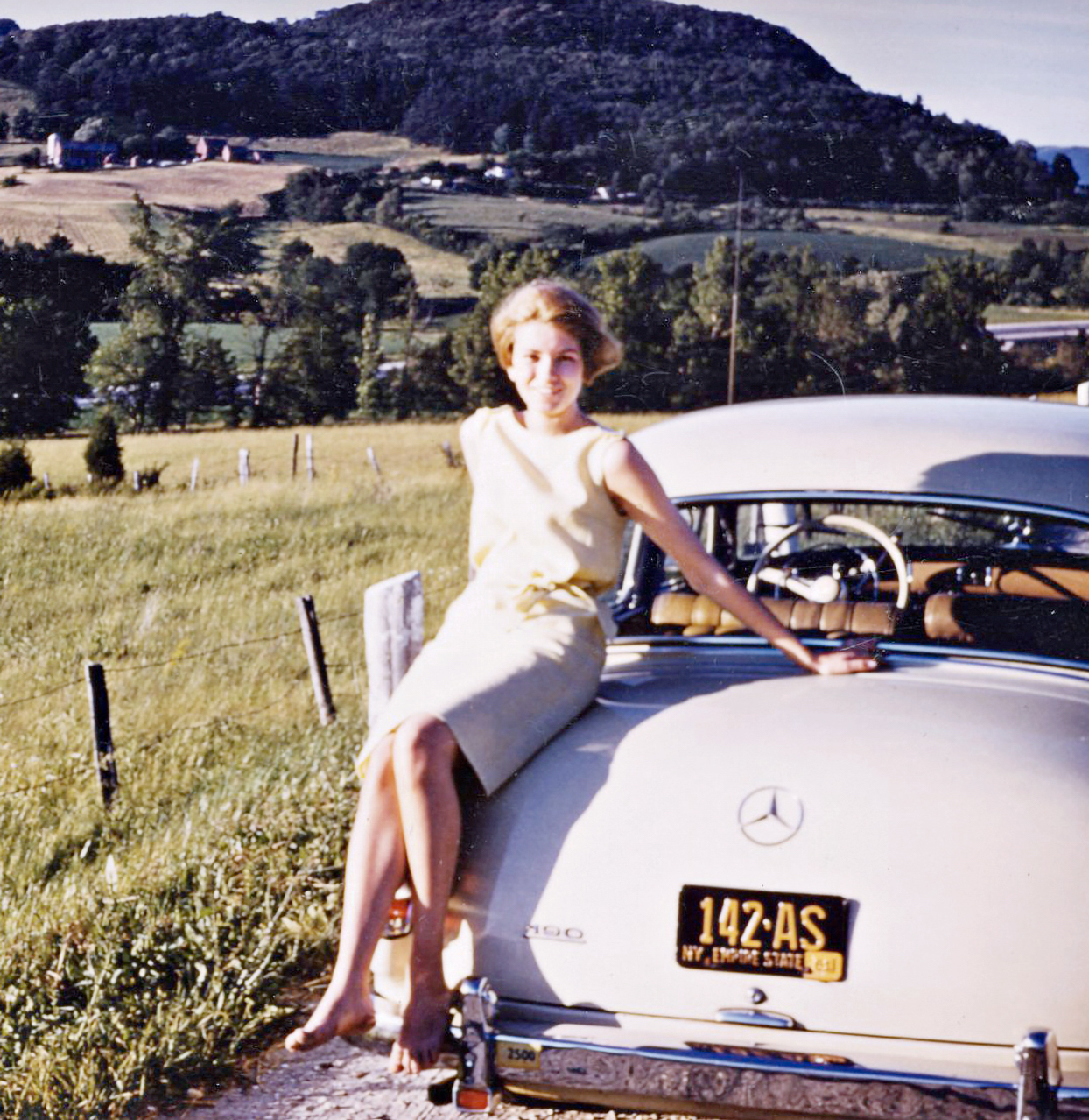 Martha Stewart on her honeymoon beside a vintage car