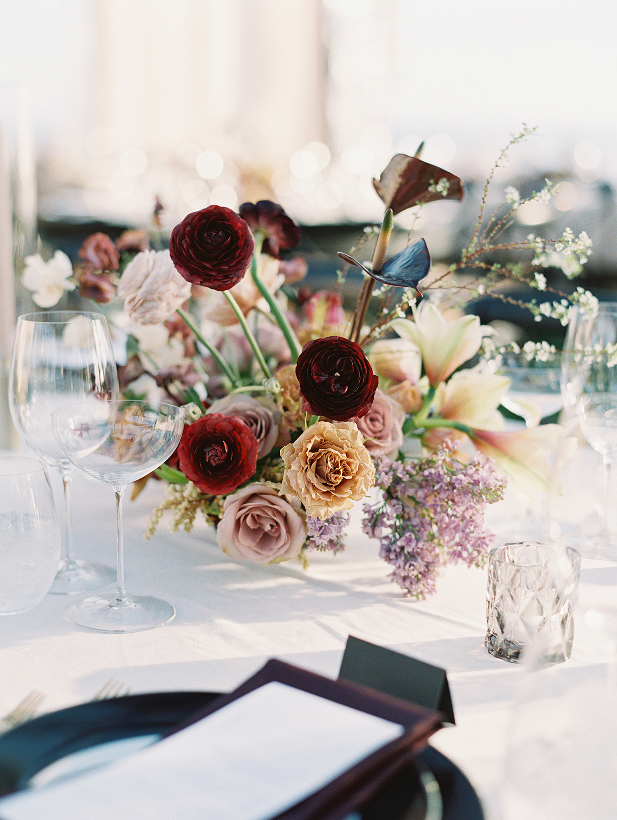 elegant warm tones floral centerpieces on white tables