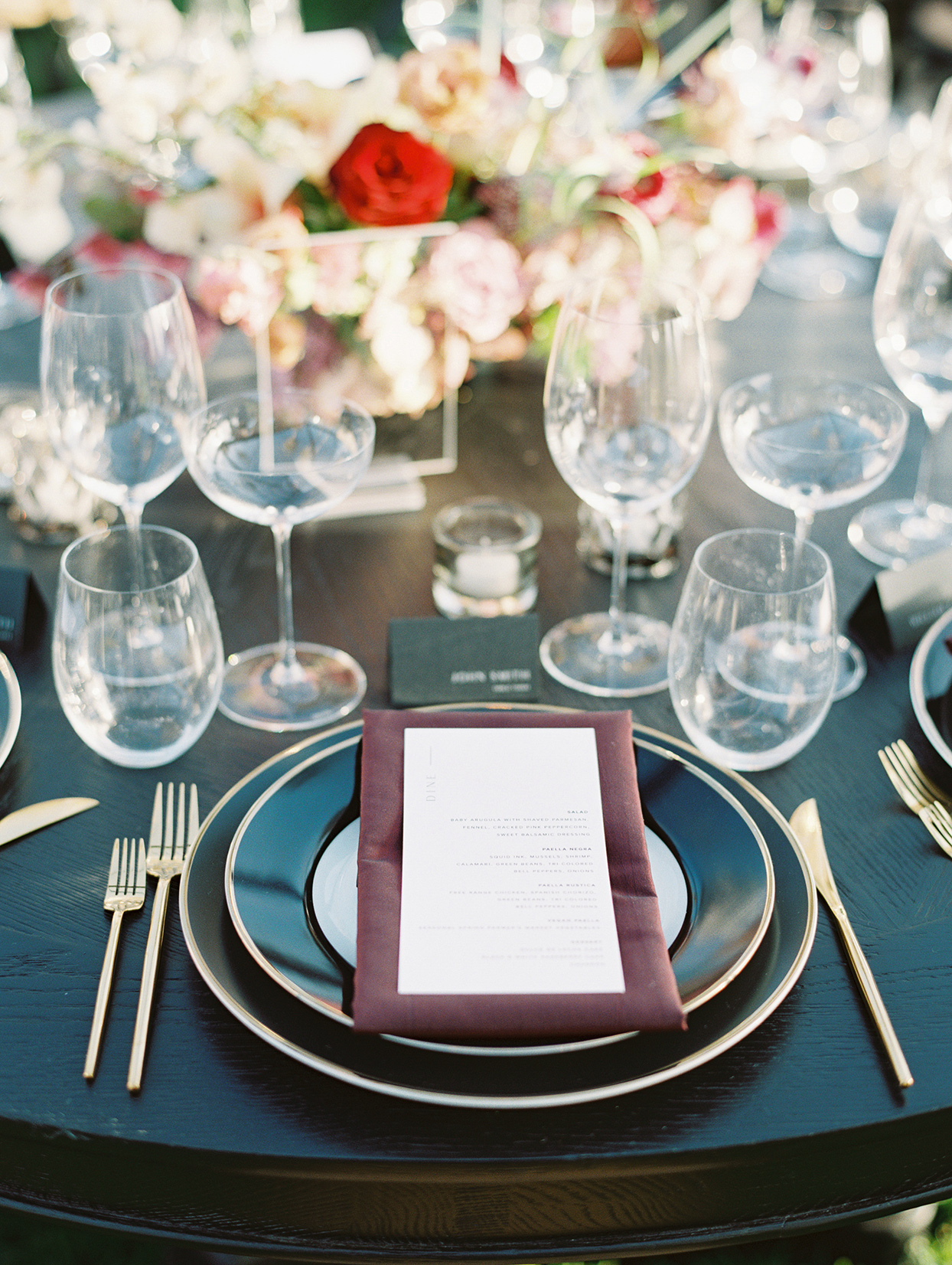 elegant black, gold and maroon place setting