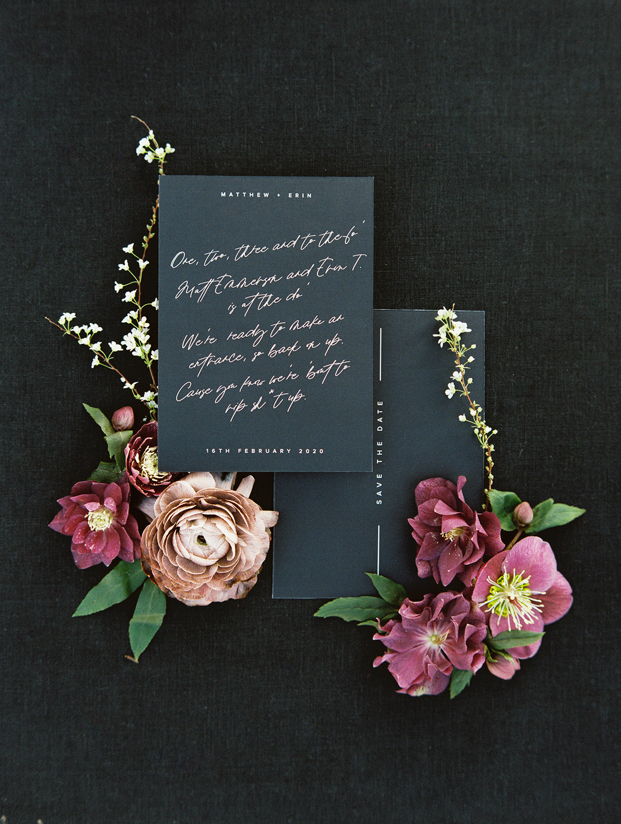 personalized save the date rap on black and gold stationary with maroon flowers