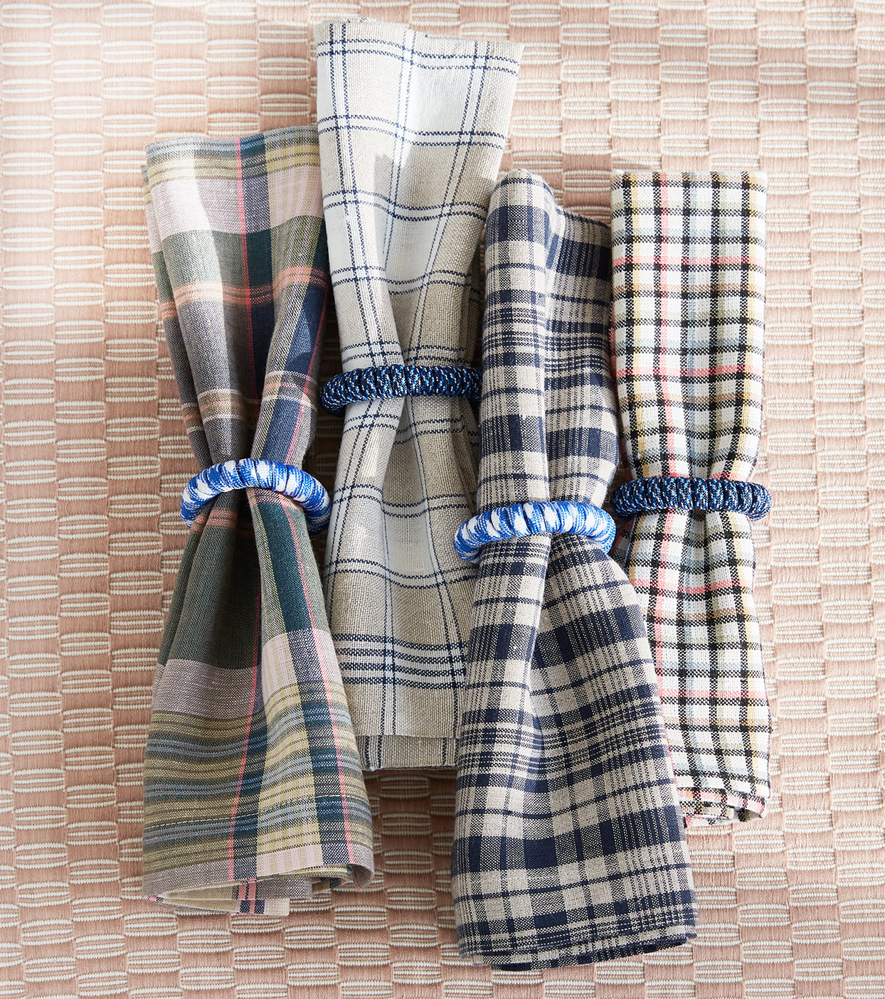 Four patterned napkins on table cloth