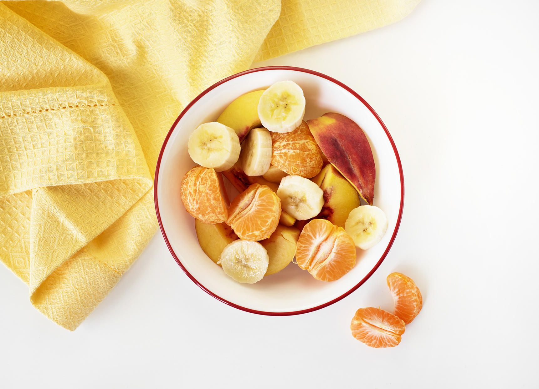 citrus fruit in a bowl with yellow towel