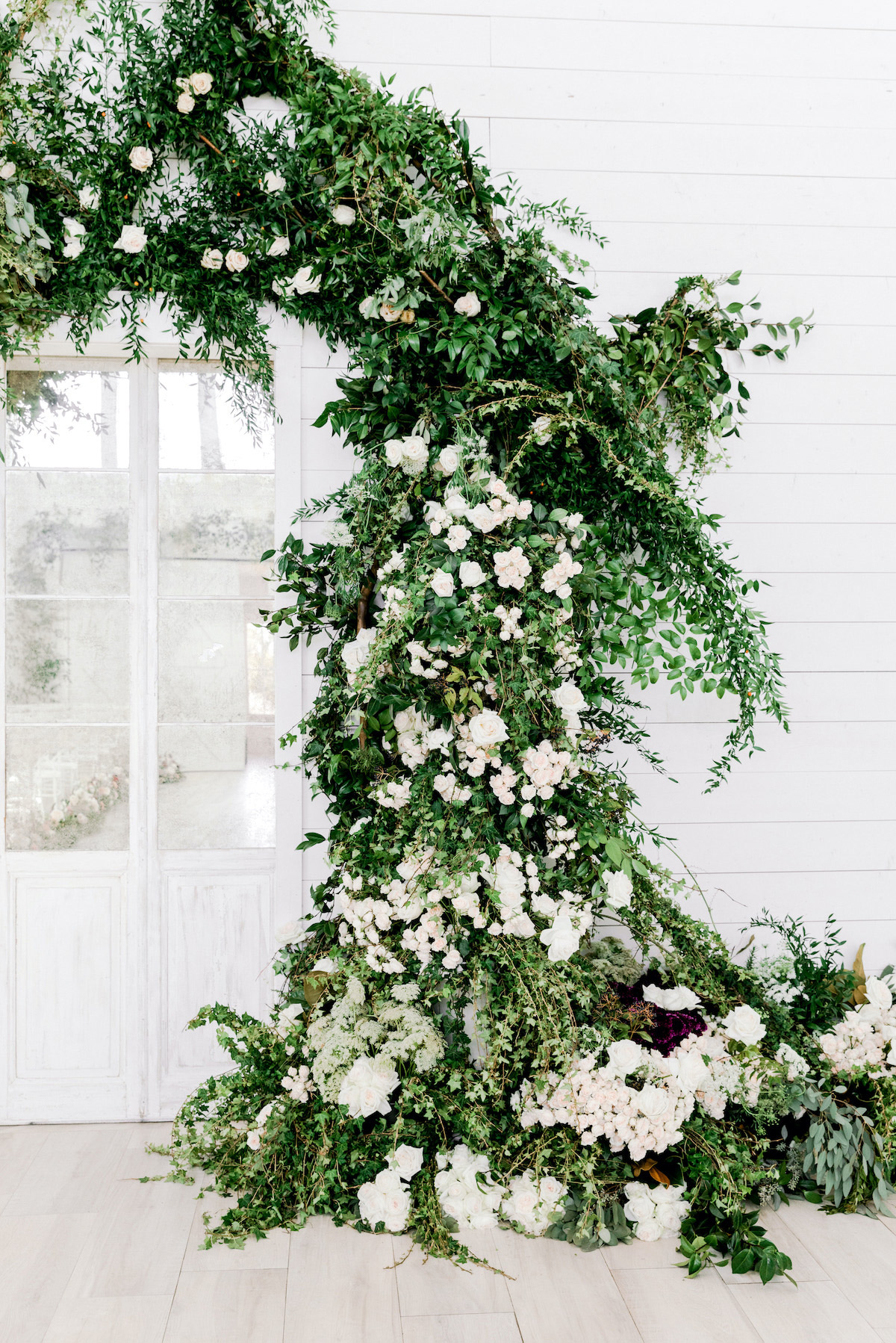 elegant white floral and greenery wedding arch