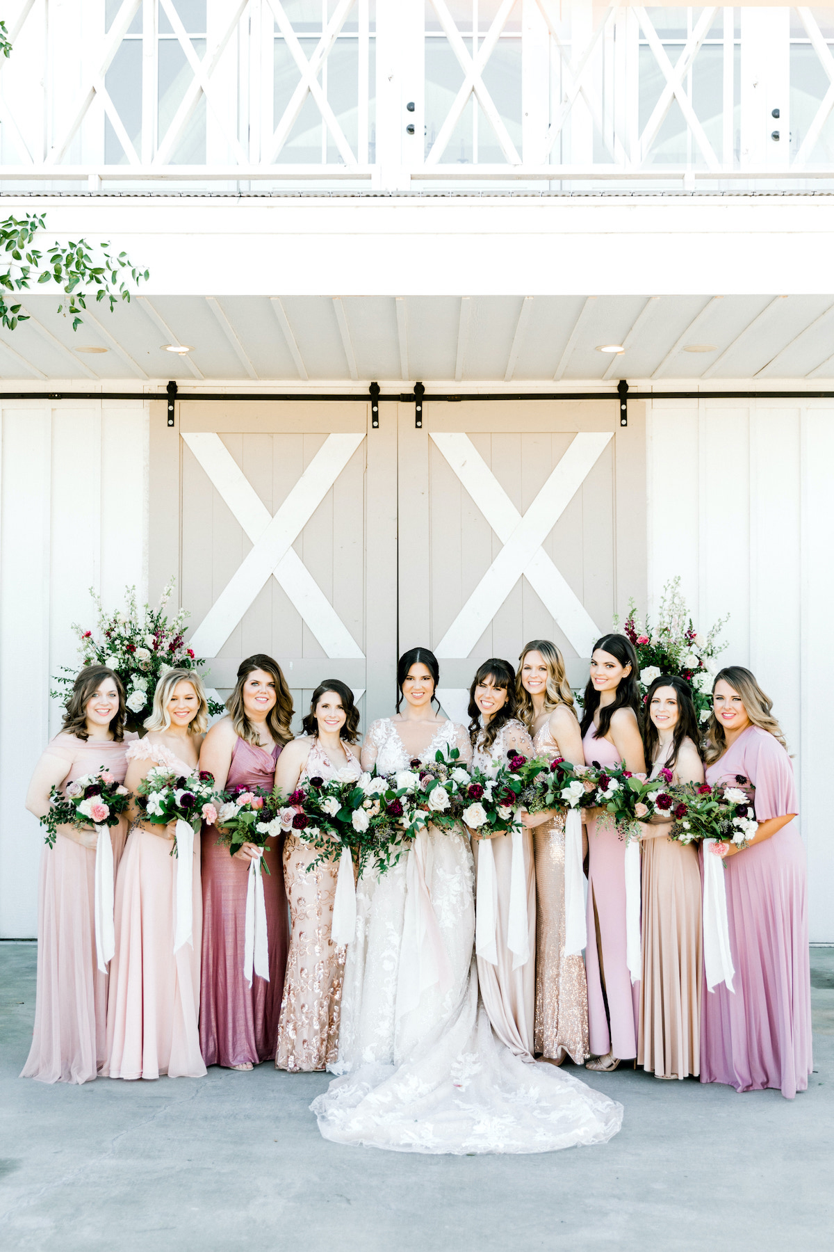 bride and bridesmaids in pink and purple jewel tones