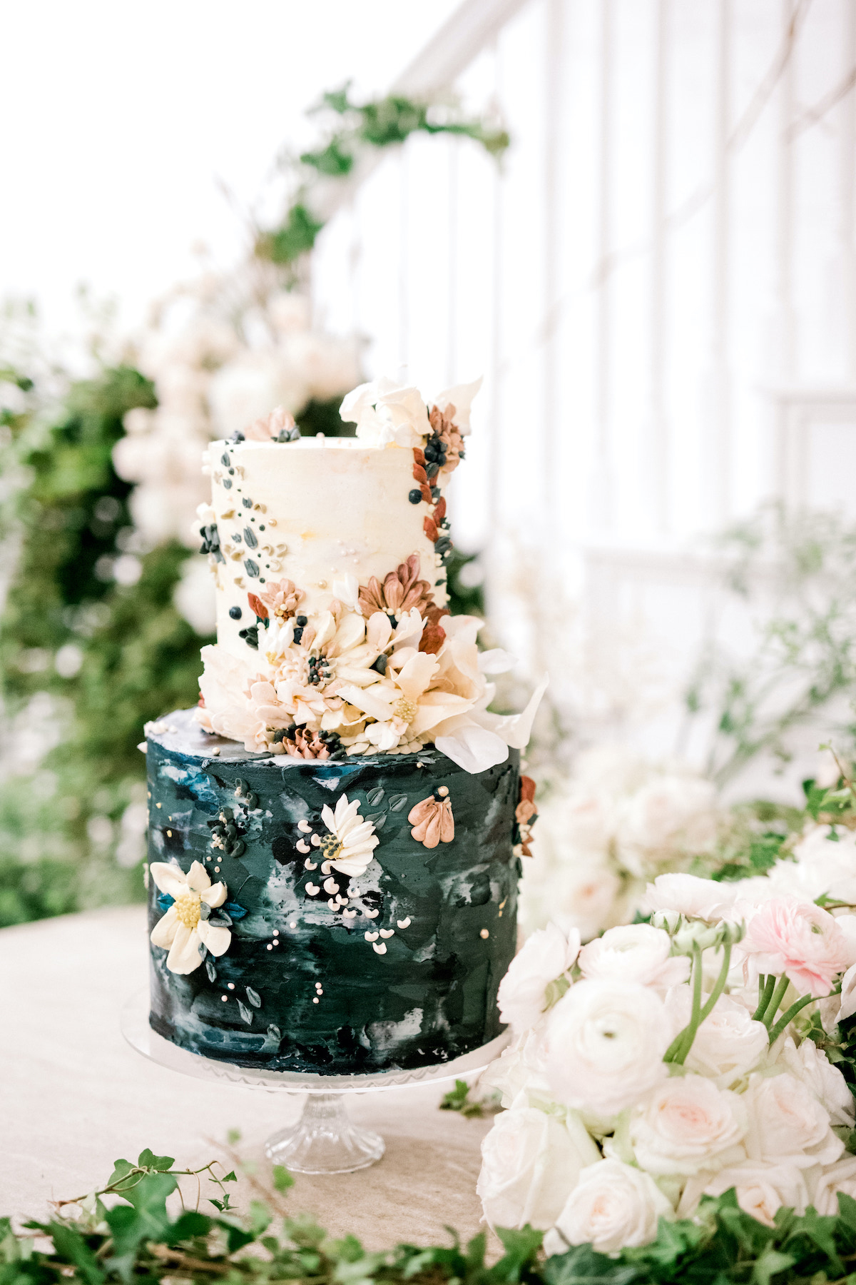 black and pastel pink wedding cake with flowers