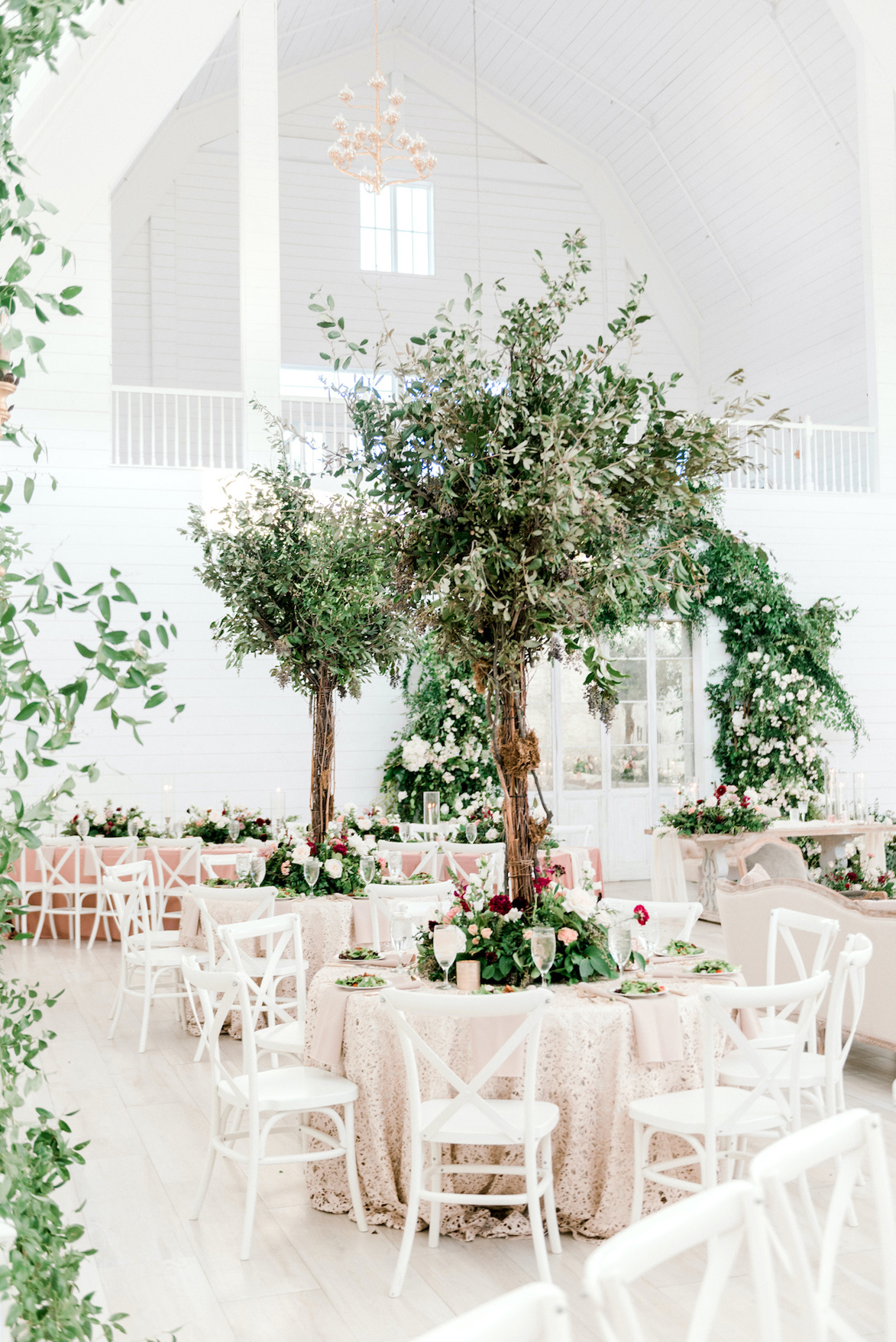 wedding reception space in white, pastel pink and greenery