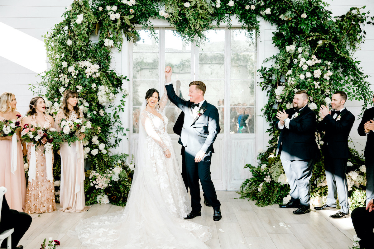 couple celebrating during ceremony after vows