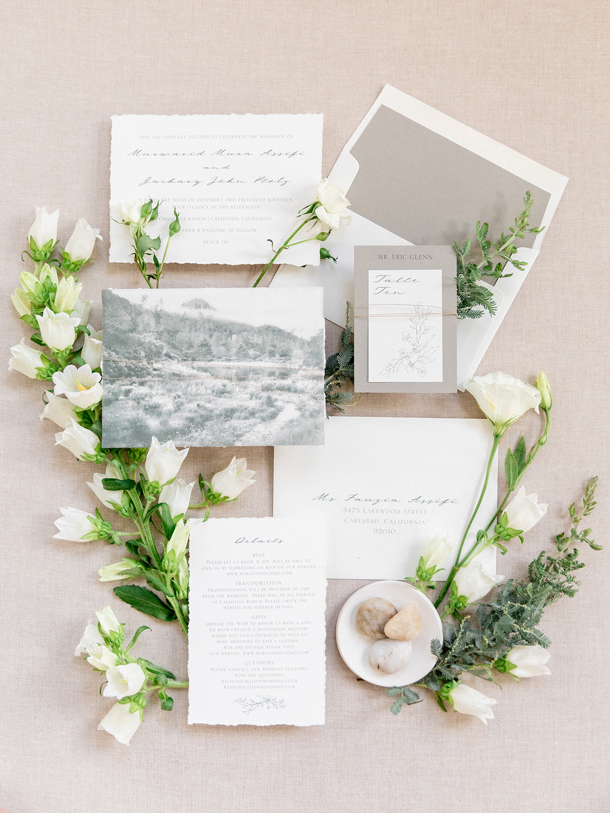 white and neutral elegant wedding invitation suite with flowers