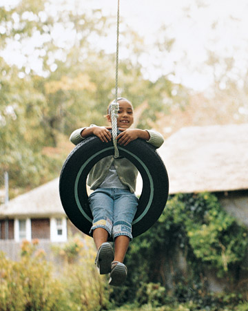 """Get to swinging with this fun addition to your yard. Begin by drilling a 3/8-inch hole through the limb of a tree. Attach an eyebolt with a washer and locknut. Loop the rope around the tire; then tie a knot. Loop the other end around the quick link, adjusting the length as necessary (a tire should hang high enough so feet won't drag, but it should be low enough so kids can stop themselves); cut off any excess rope. Lastly secure the knot and fasten to the eyebolt, and you will be ready to hop on.Shop Now: Power King Boat Trailer LP Tire, 20.5"""" by 8,"""" $45.54, homedepot.com; T.W. Evans Cordage Royal Oak Cotton Sash Cord, 6"""" by 12,"""" homedepot.com."""
