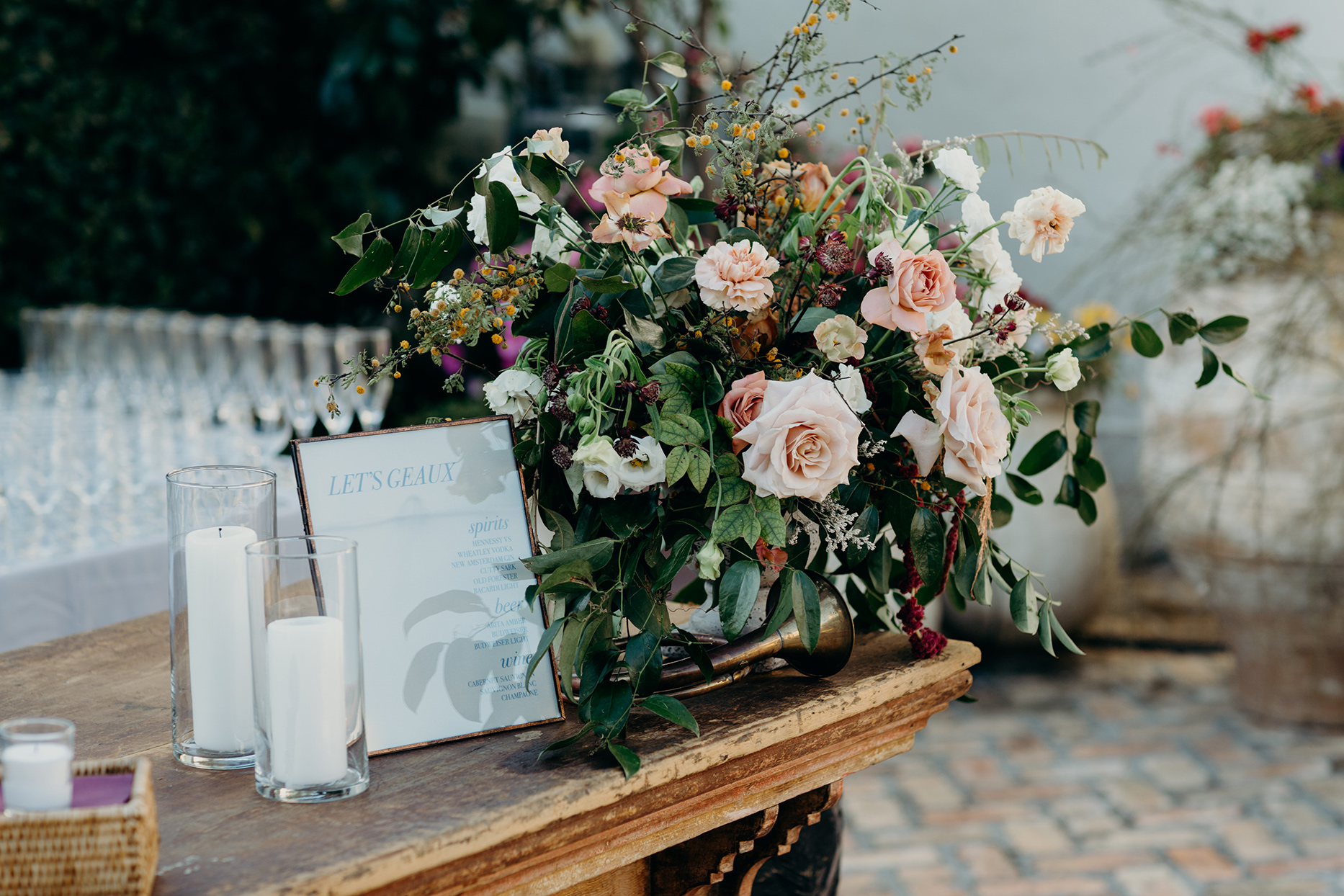 wedding ceremony rustic wooden bar with floral bouquet