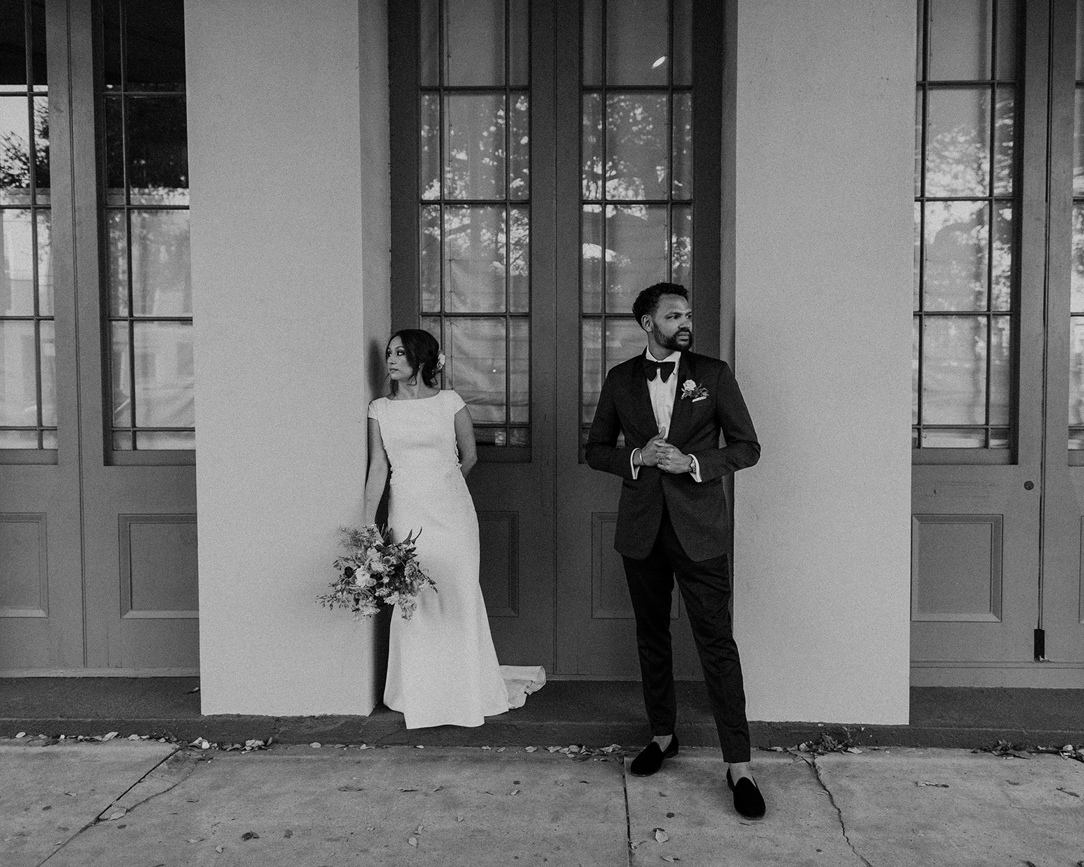 wedding couple black and white portrait in front of doors