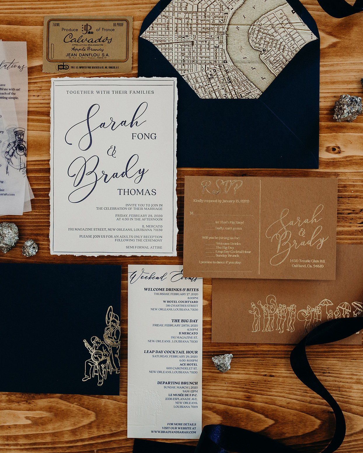 deep blue, brown and white wedding invitation suite