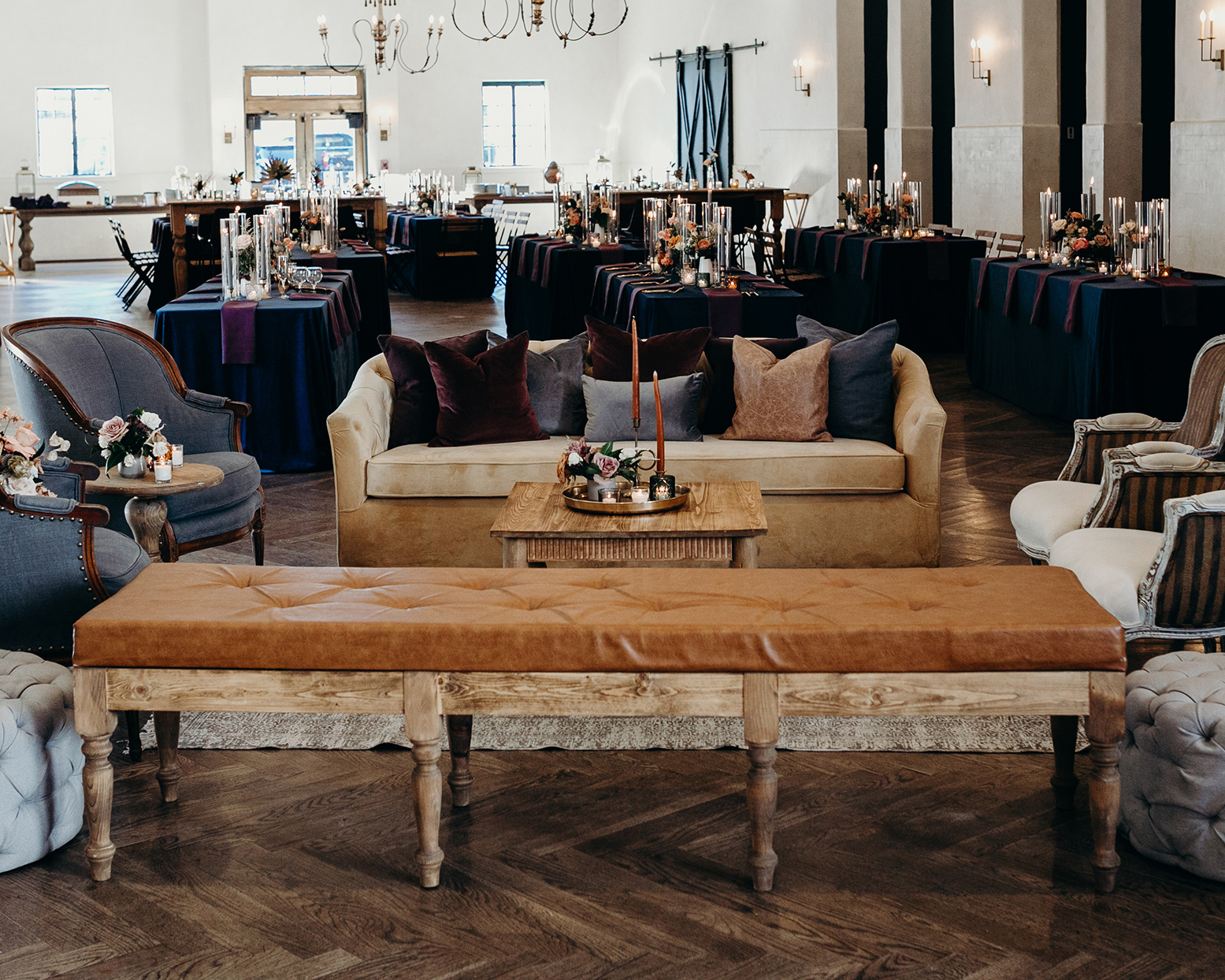 deep colored brown, maroon and blue wedding reception lounge area