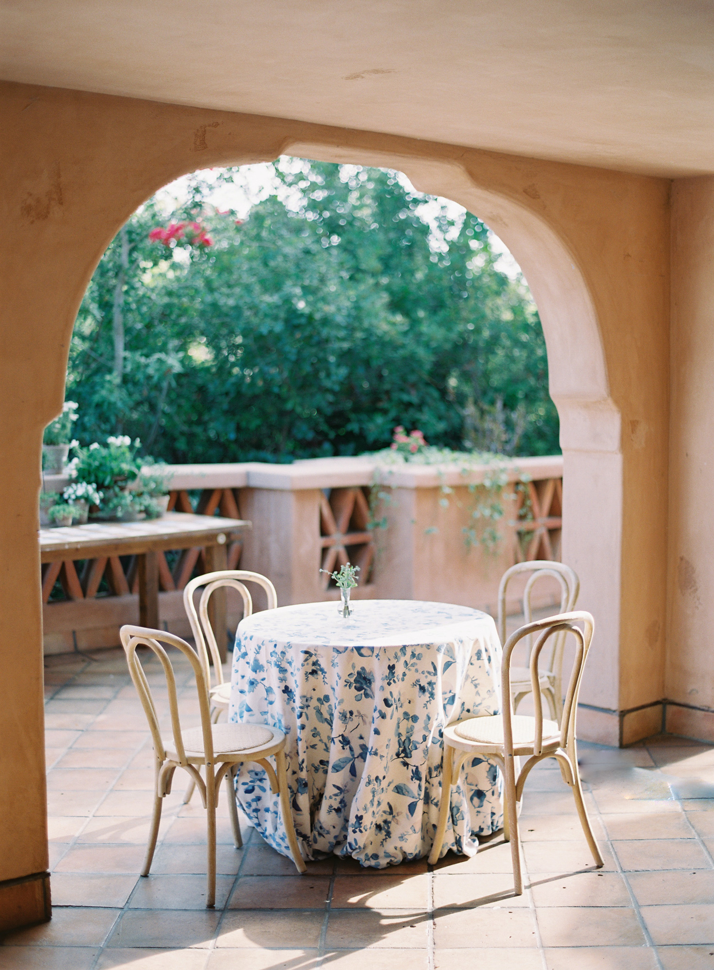 4-person table with blue and white floral table cloth