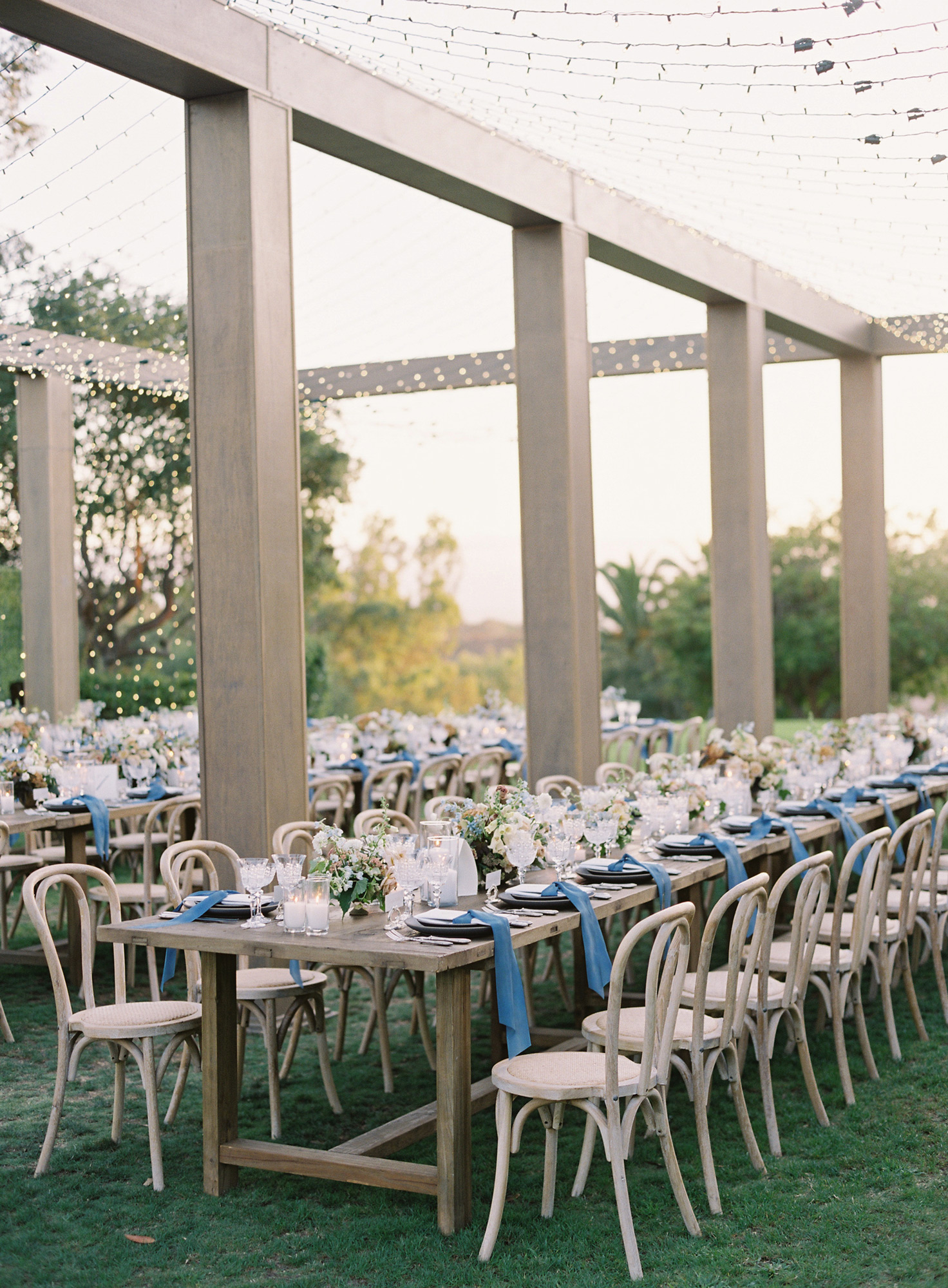 day shot reception tables among gold columns white lights