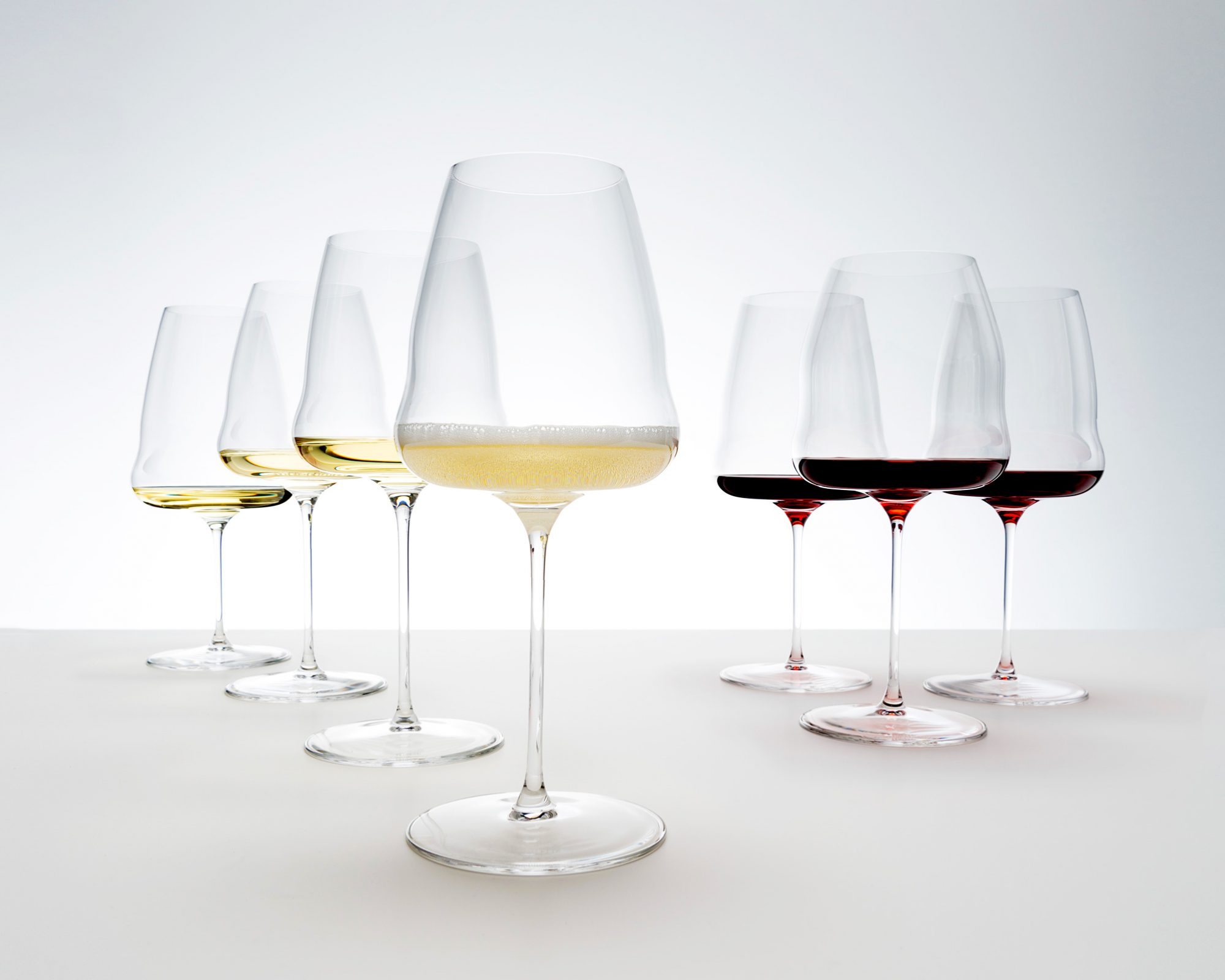group of wine glasses with red and white wine