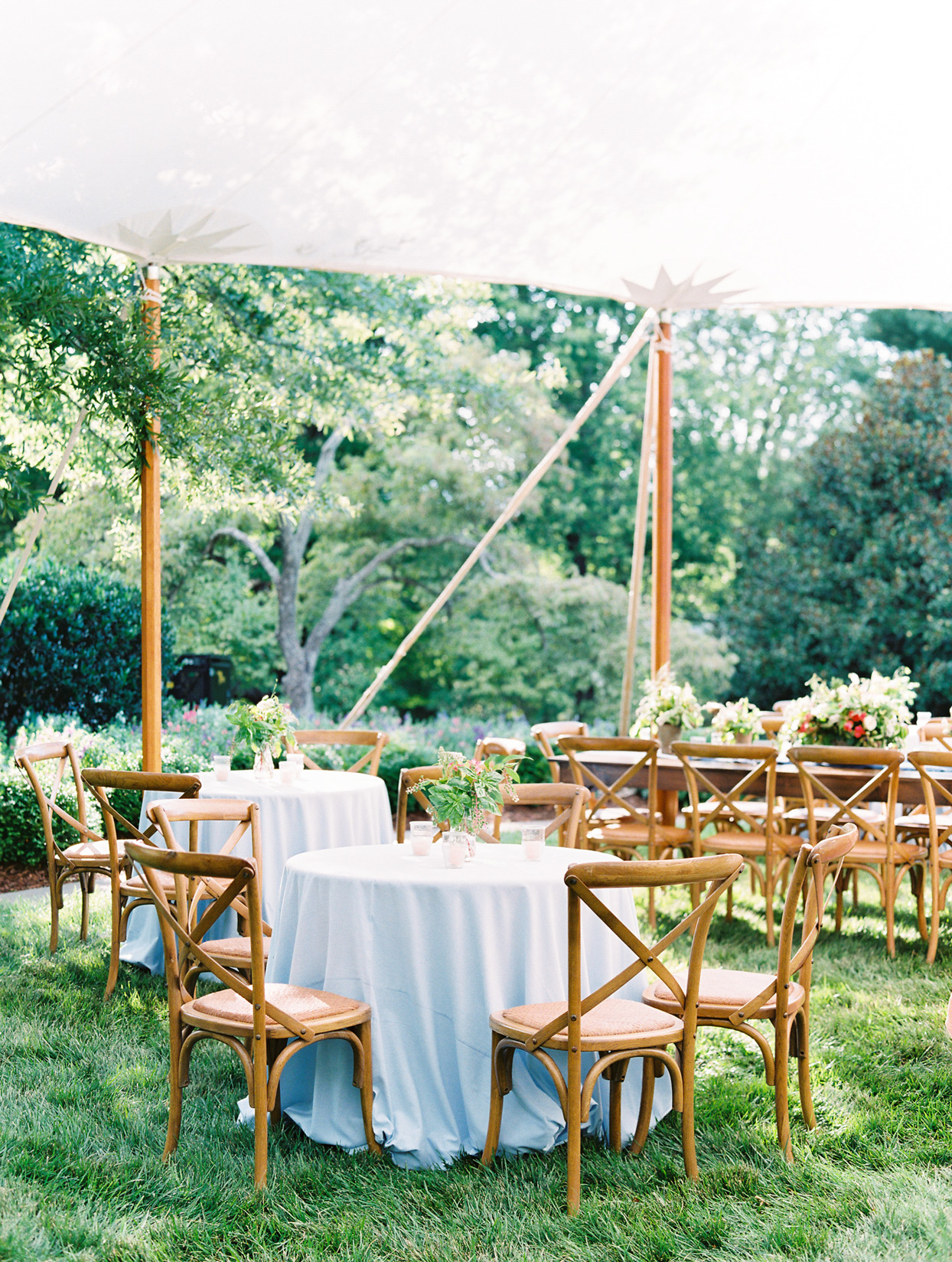 anniversary party tables white linens outdoor tent space