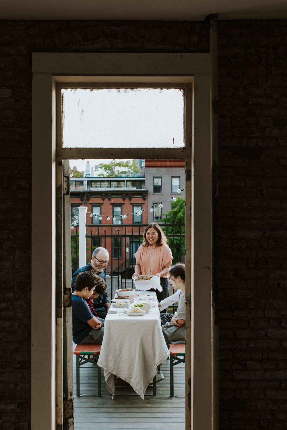 hetty mckinnon and family havng dinner on their patio