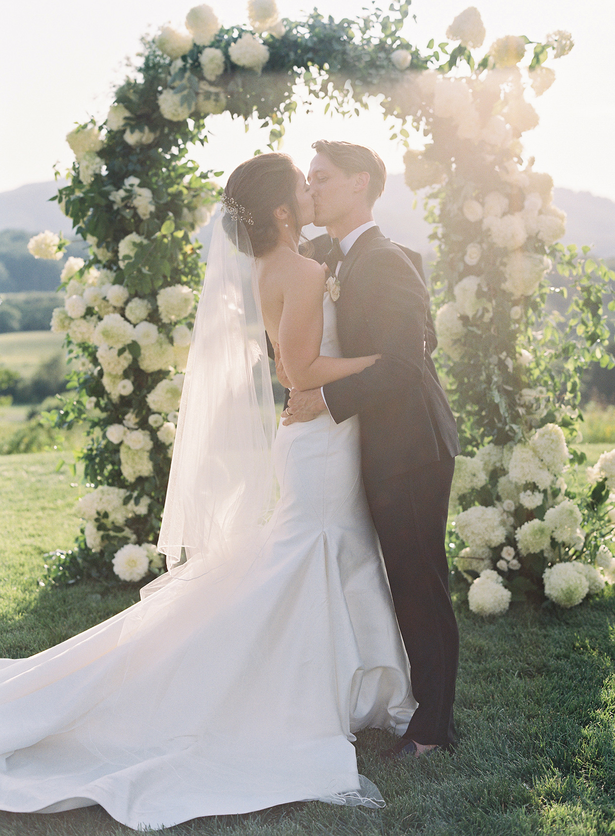 wedding couple kissing at ceremony after vows